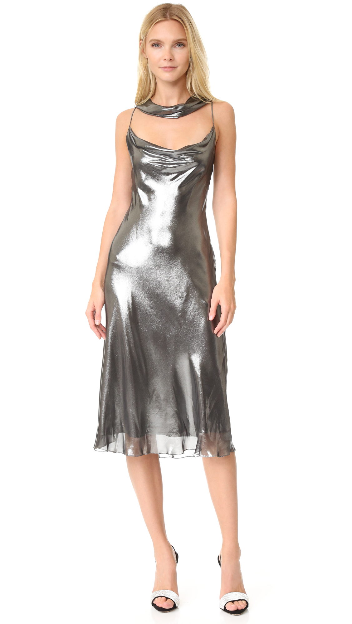 A glamorous Cushnie Et Ochs midi dress with a striking, liquid like luster. A sash drapes at the deep cowl neckline. Hidden back zip. Silk lining. Fabric: Metallic chiffon. Shell: 100% polyester. Lining: 100% silk. Dry clean. Made