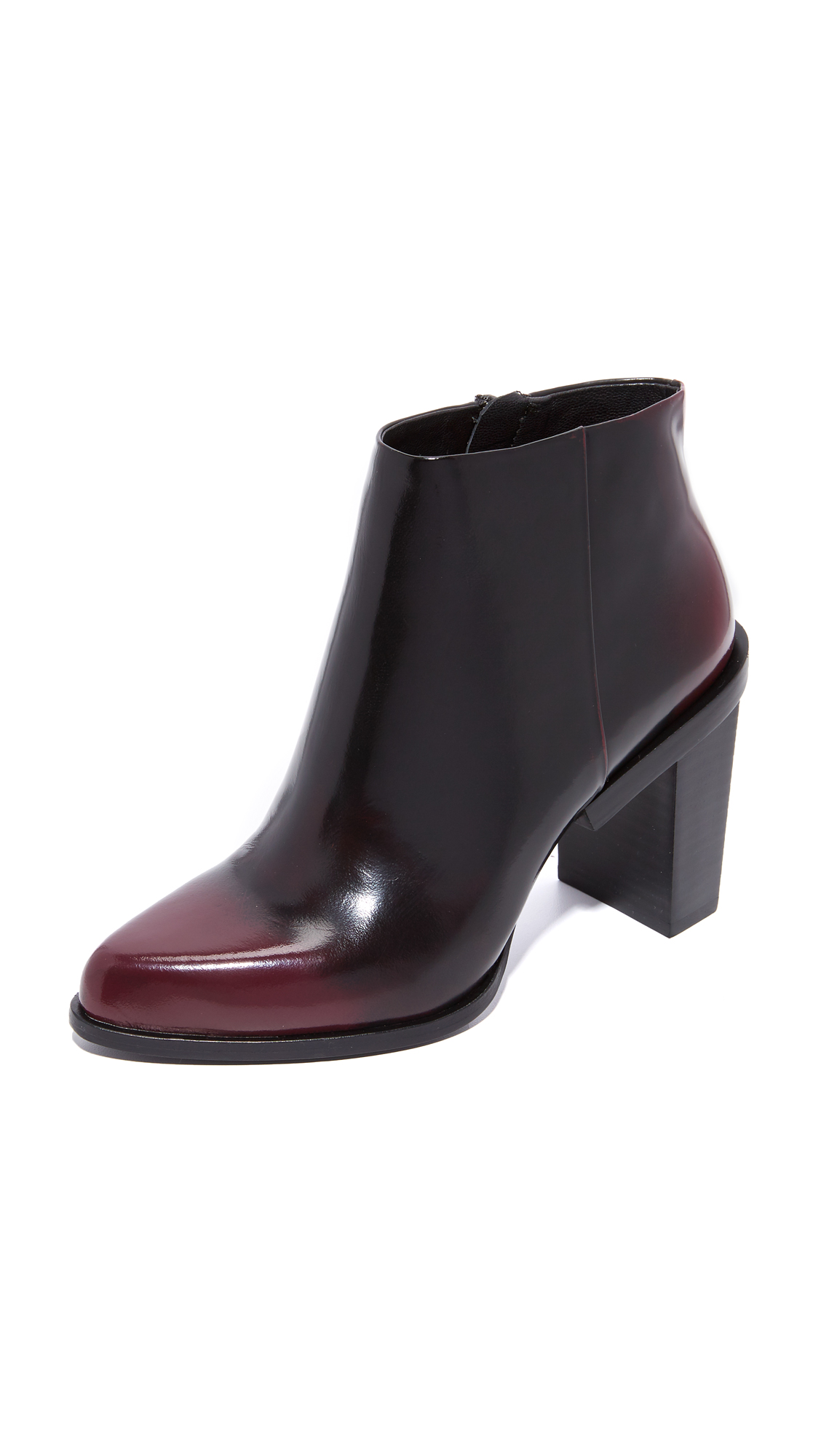 Glossy, two tone leather adds a unique appeal to these pointed toe DKNY boots. Partial platform and a geometric stacked heel. Hidden side zip. Leather sole. Leather: Cowhide. Imported, China. This item cannot be gift boxed.