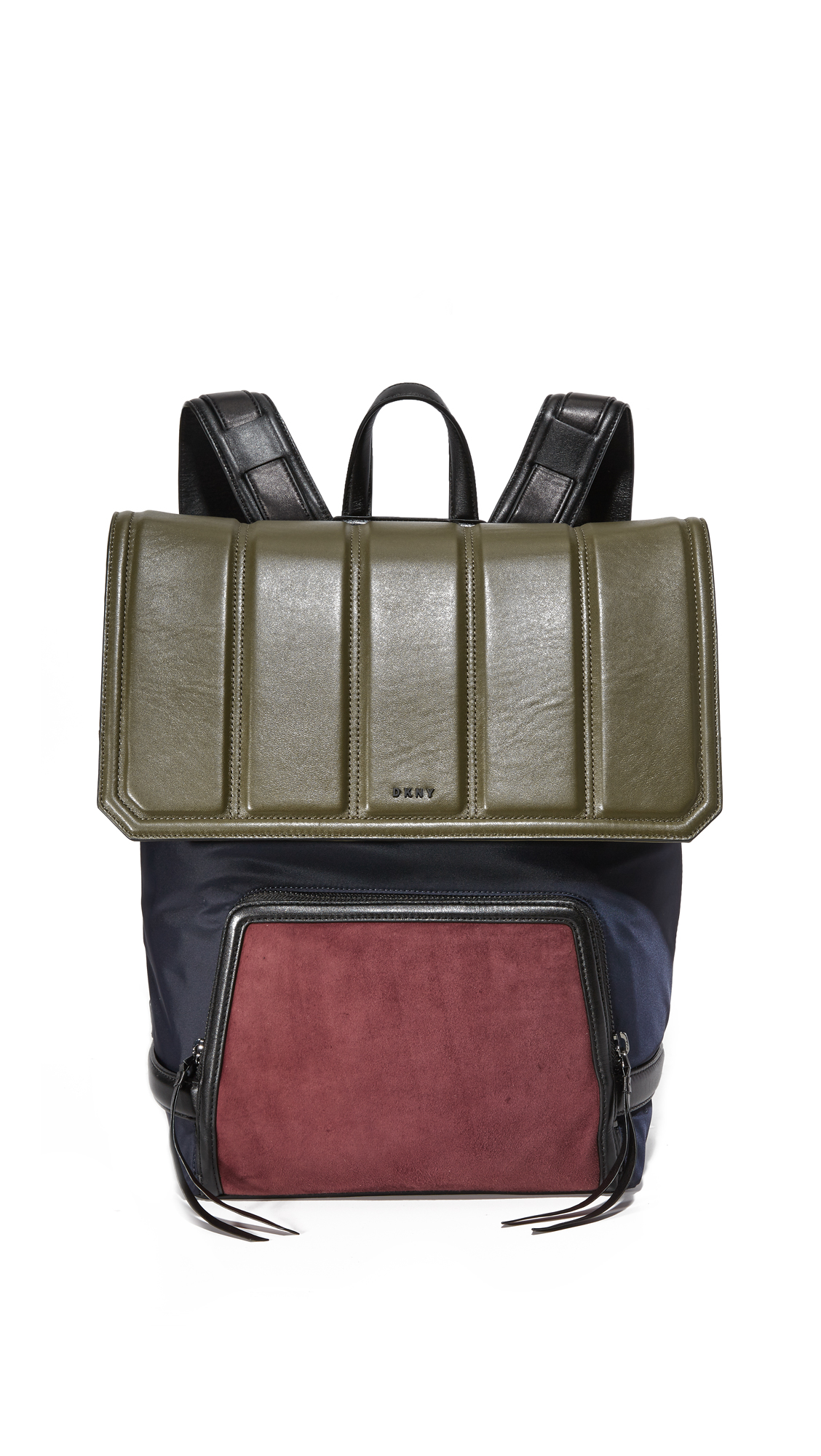 A colorblock DKNY backpack rendered in quilted lambskin, suede, and technical weave. The branded top flap lifts over a zip pouch. A magnetic pocket outfits the back. Adjustable shoulder straps and top handle. Dust bag included.