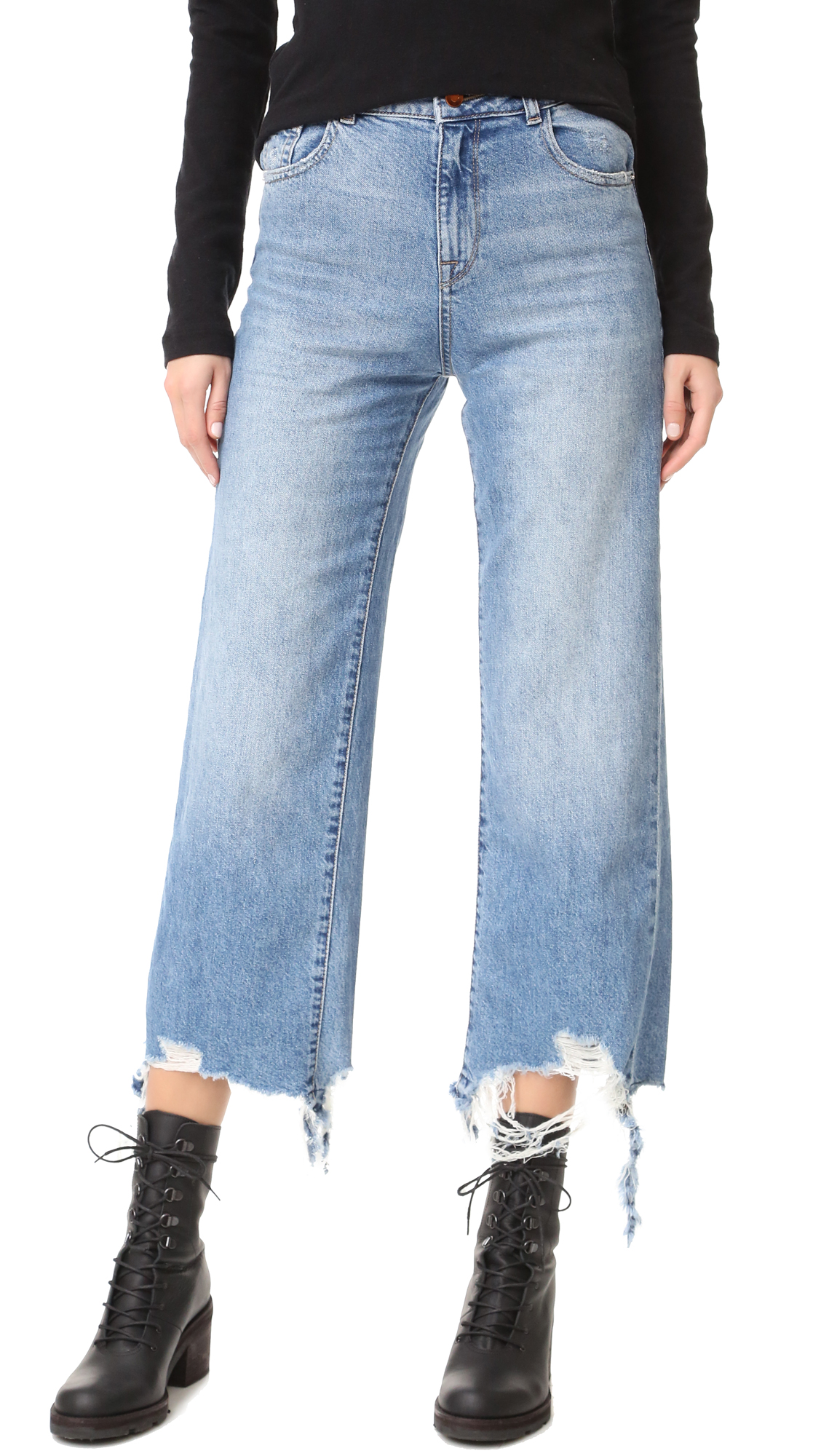 Soft, well worn DL1961 boyfriend jeans with a roomy, relaxed fit. Exaggerated shredding at the hems. 5 pocket styling. Button closure and zip fly. Fabric: Soft denim. 100% cotton. Wash cold. Made in the USA. Measurements Rise: 12.25in / 31