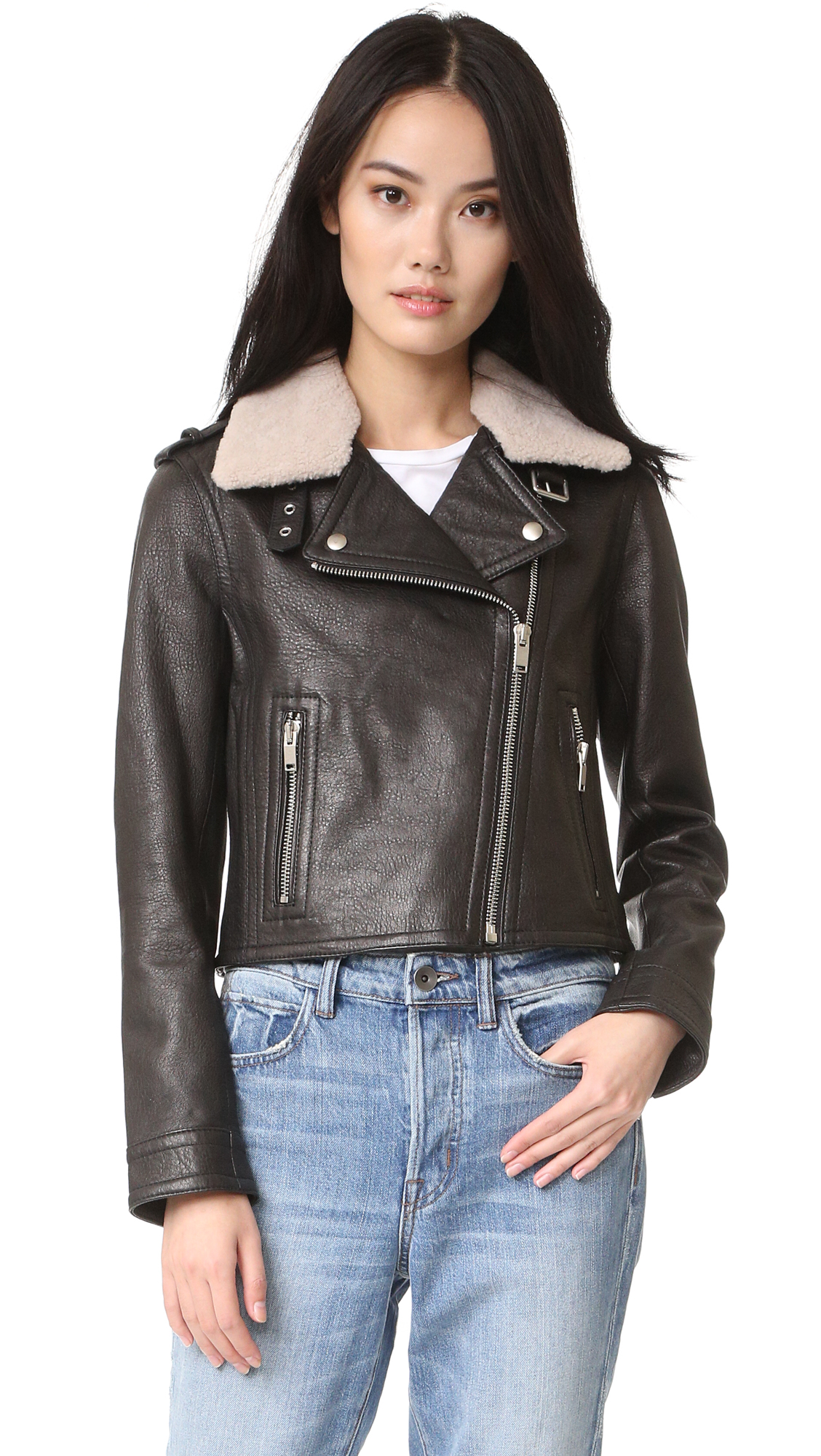 A cropped Doma moto jacket in luxe bubble leather, styled with an optional shearling collar. Off center zip placket. Zip front pockets and zip cuffs. Lined. Fur: Dyed lamb shearling, from China. Fabric: Leather. Shell: 100% lambskin.