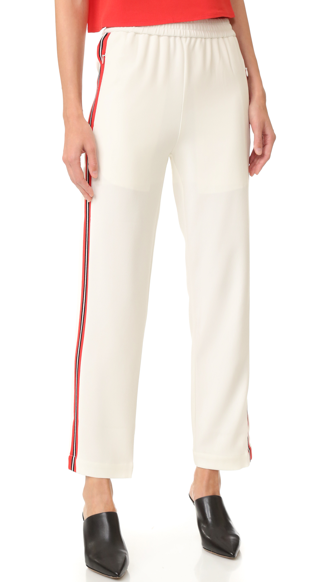 Bright racing stripes streak the sides of these luxe crepe Edition10 joggers. Smocked elastic waist. Hidden zip pockets at hips. Lined. Fabric: Crepe. Shell: 69.8% triacetate/30.2% polyester. Trim: 100% polyester. Wash cold. Imported, China. Measurements Rise: 11.5in / 29cm