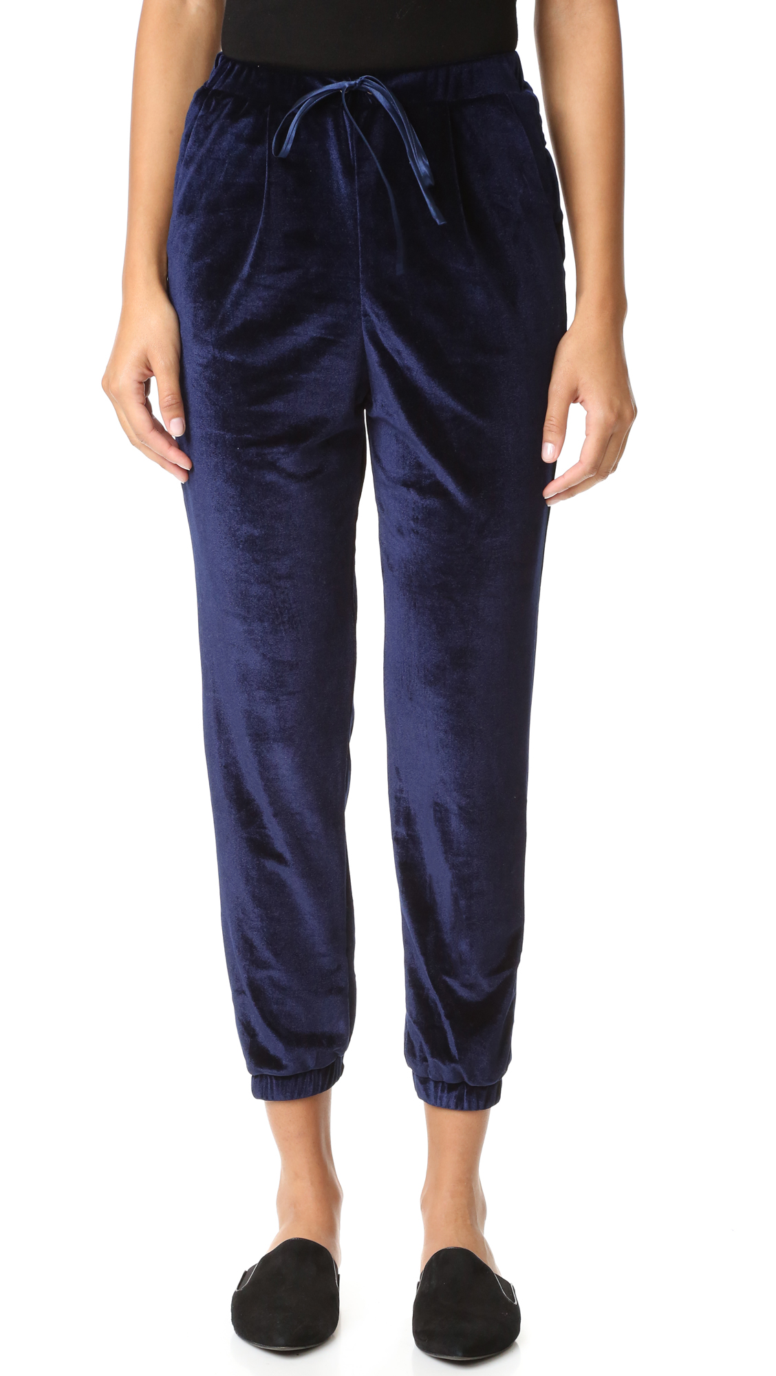 Slouchy ENGLISH FACTORY pants in soft velour. Gathered elastic cuffs. Slant hip pockets and faux welt back pockets. Elastic waistband with drawstring. Fabric: Velour. 100% polyester. Wash cold. Imported, China. Measurements Rise: 12.5in / 32cm Inseam: 27.25in / 69cm