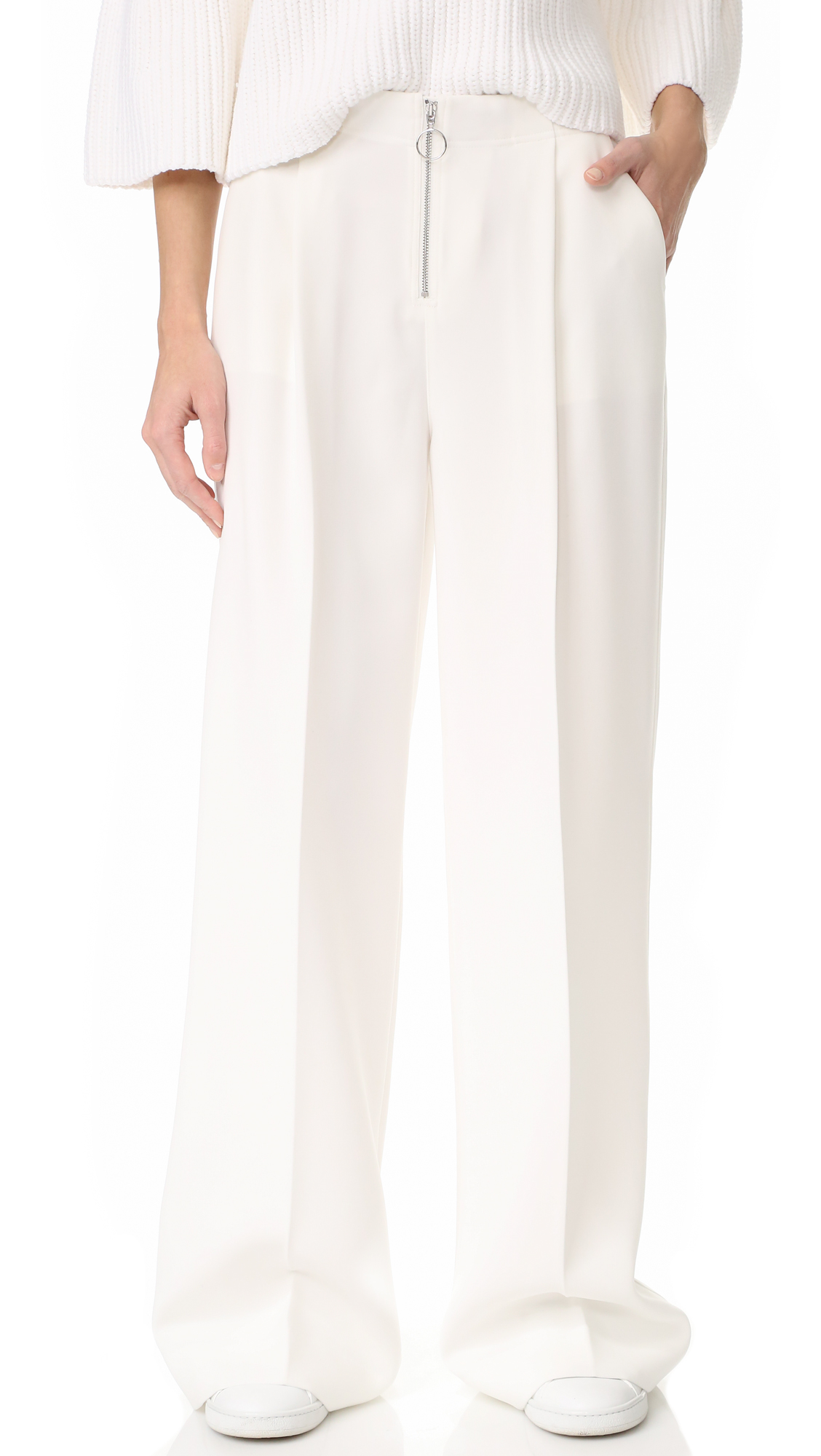 Sophisticated Elizabeth and James pants in a high waisted, wide leg profile. Slant front pockets and welt back pockets. Exposed front zip with ring pull. Fabric: Crepe. Shell: 51% polyester/49% acetate. Lining: 94% polyester/6% spandex. Dry clean. Imported,