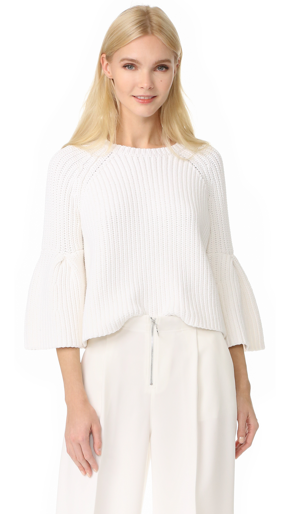 A cropped profile accentuates the boxy look of this chunky knit Elizabeth and James sweater. The raglan seams flare into full cuffs at the elbow. Crew neckline. Fabric: Ribbed knit. 65% cotton/35% nylon. Dry clean. Imported, China.