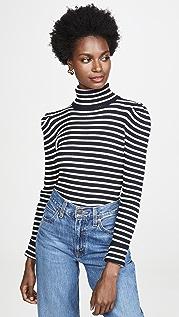 525 Пуловер в полоску с объемными рукавами