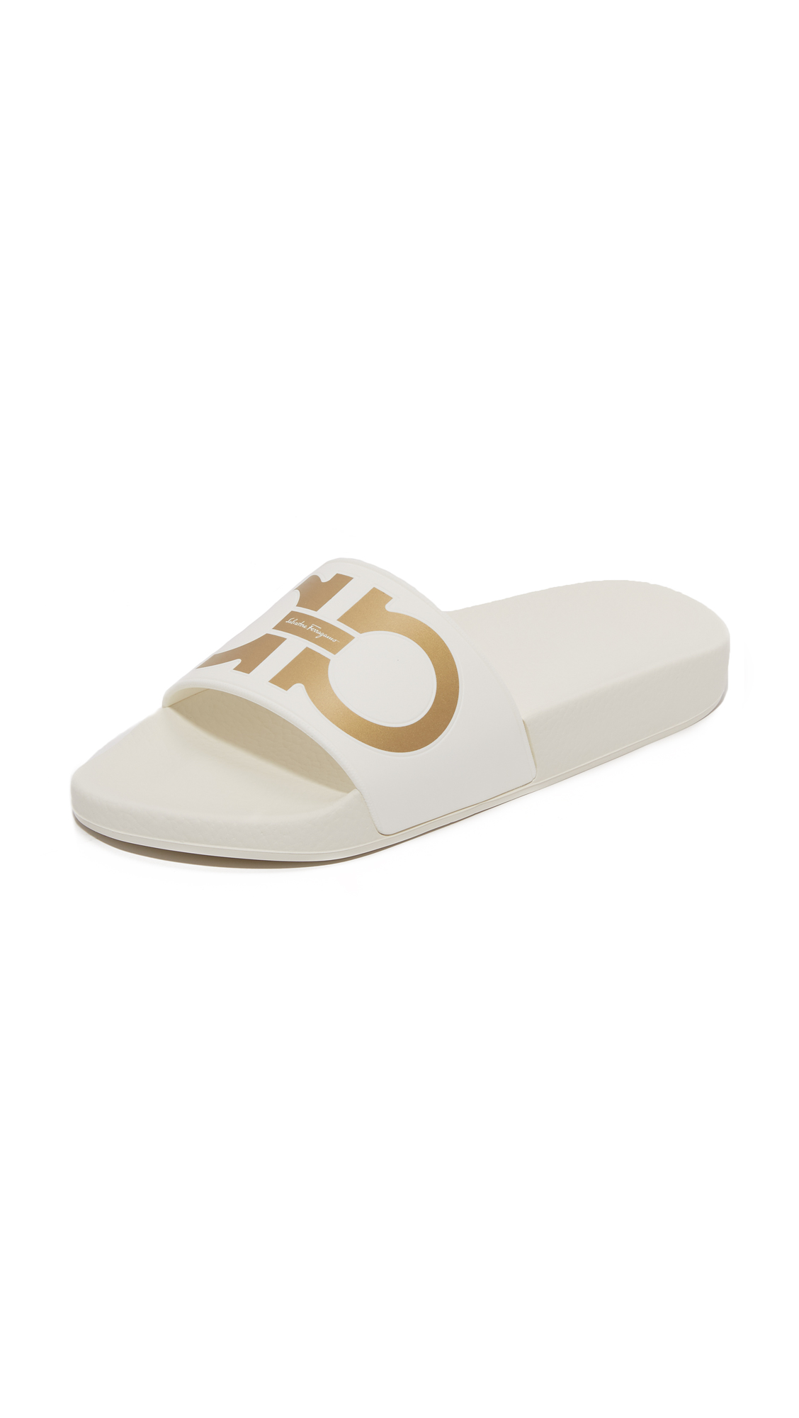 A metallic logo accents the vamp on these causal Salvatore Ferragamo slide sandals. Textured footbed and rubber sole. Fabric: Rubber. Made in Italy. Size & Fit. Available sizes: 5,6,7