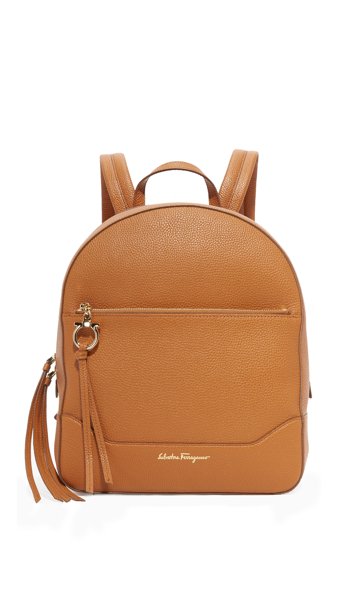 A boxy Salvatore Ferragamo backpack in pebbled leather. Zip front pocket with logo charm and slim back pocket. Wraparound top zip and lined, 1 pocket interior. Locker loop and adjustable shoulder straps. Dust bag included. Leather: Calfskin.