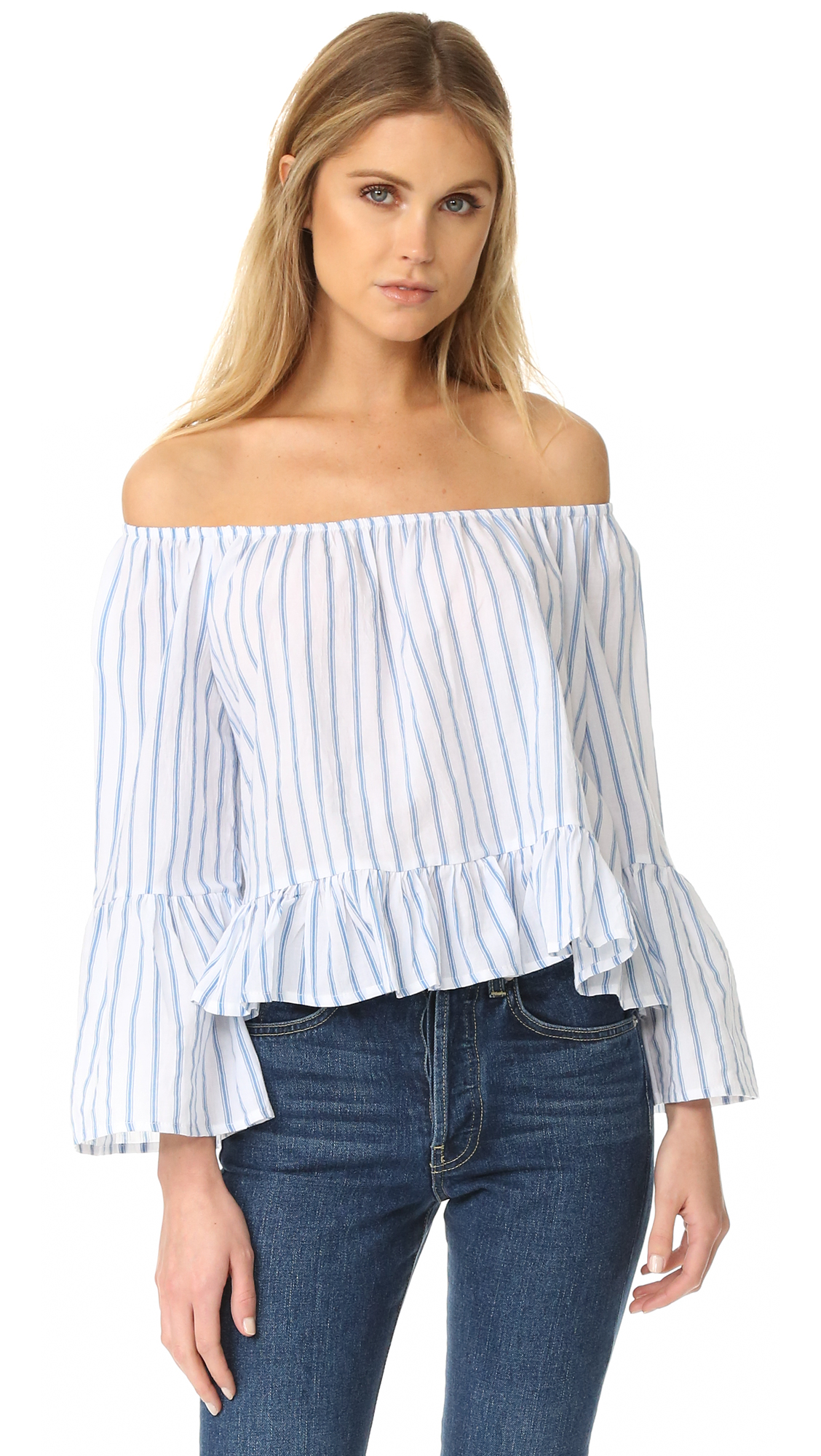 This breezy FAITHFULL THE BRAND off shoulder top is detailed with understated stripes. Elastic neckline. Long sleeves and flared cuffs. Fabric: Voile. 100% cotton. Hand wash. Imported, Indonesia. Measurements Length: 18.5in / 47cm, from center back Measurements from