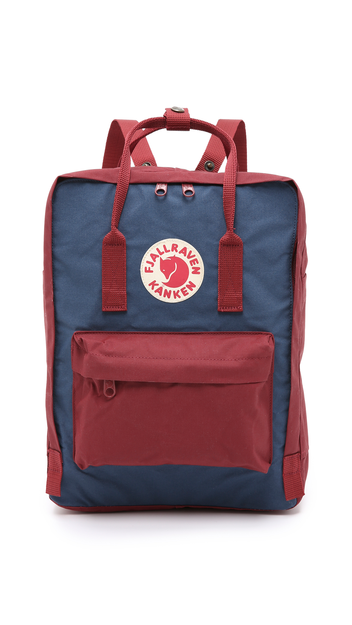 A 2 tone Fjällräven backpack, detailed with a reflective logo patch and zip front pocket. Patch side pockets offer easy access to essentials. 2 way zip top. A removable foam panel adds extra protection to the
