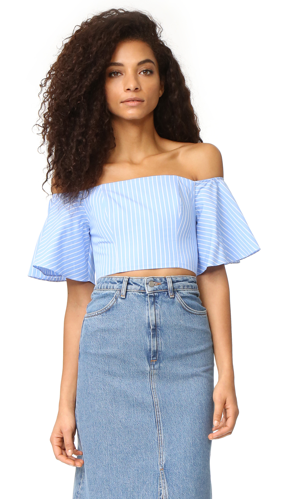 Flexible boning lends shape to this off shoulder Fame and Partners crop top. Covered elastic cinches the top of the flared short sleeves. Hidden back zip. Nonslip rubber binding at top hem. Fabric: Poplin. 100% cotton. Wash