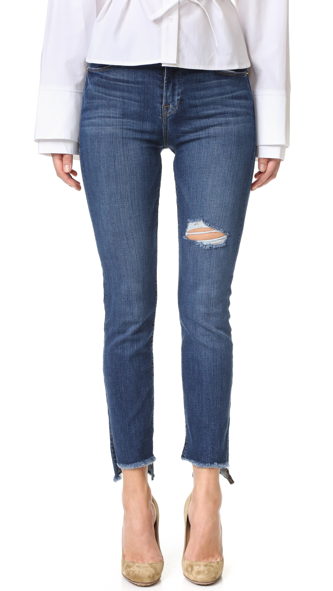 Shredded holes and a raw hem soften these high waisted FRAME straight leg jeans. 4 pocket styling. Button closure and zip fly Fabric: Stretch denim. 93% cotton/5% polyester/2% elastane. Wash cold. Made in the USA. Imported materials. Measurements