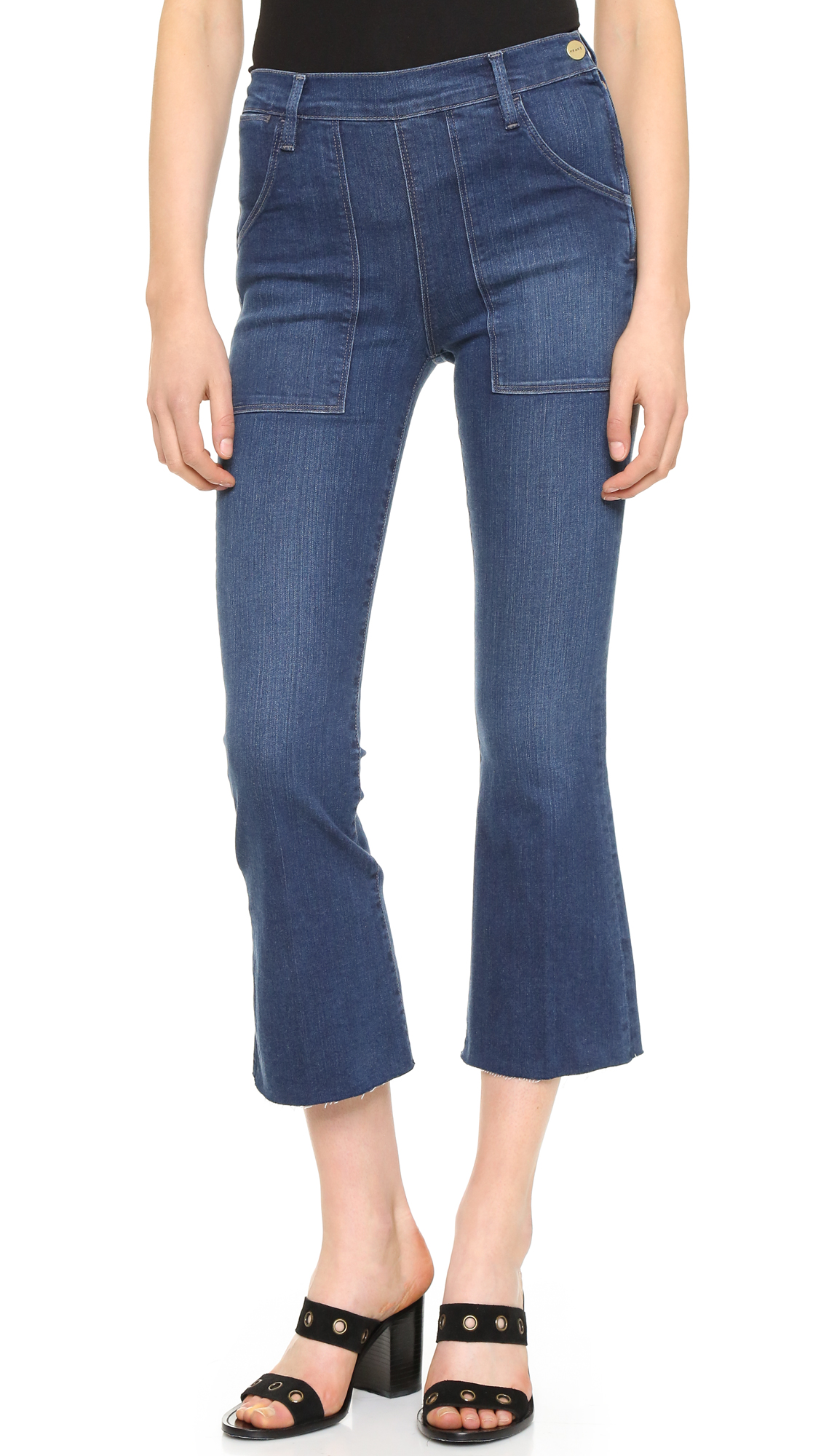 A high rise and raw hem lend vintage charm to these cropped FRAME jeans. 5 pocket styling. Snap and zip closure at side. Fabric: Lightweight stretch denim. 93% cotton/5% polyester/2% elastane. Wash cold. Made in the USA. Imported