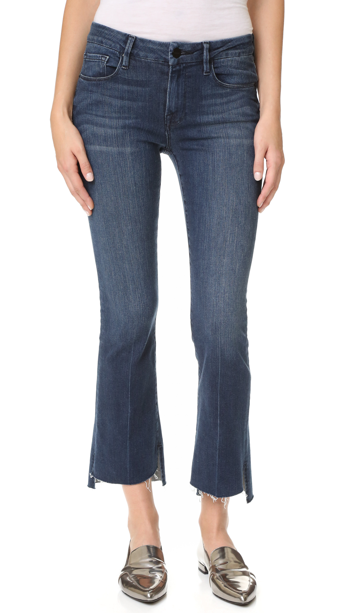 Short vents relax the raw, uneven hems on these cropped FRAME jeans. Fading and whiskering lend a broken in effect. 5 pocket styling. Button closure and zip fly. Fabric: Lightweight super stretch denim. 93% cotton/5% polyester/2% elastane. Wash