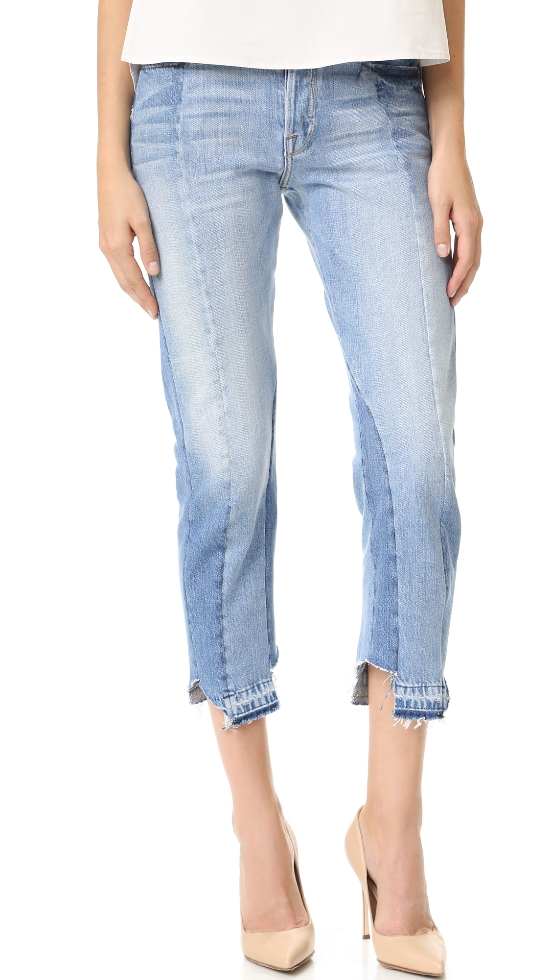 Relaxed FRAME jeans, composed of patchwork denim in a mixed wash. The raw hems are notched at the sides, and frayed spots accent the waistband. 5 pocket styling. Button fly. Fabric: Denim. 100% cotton. Wash cold. Made in