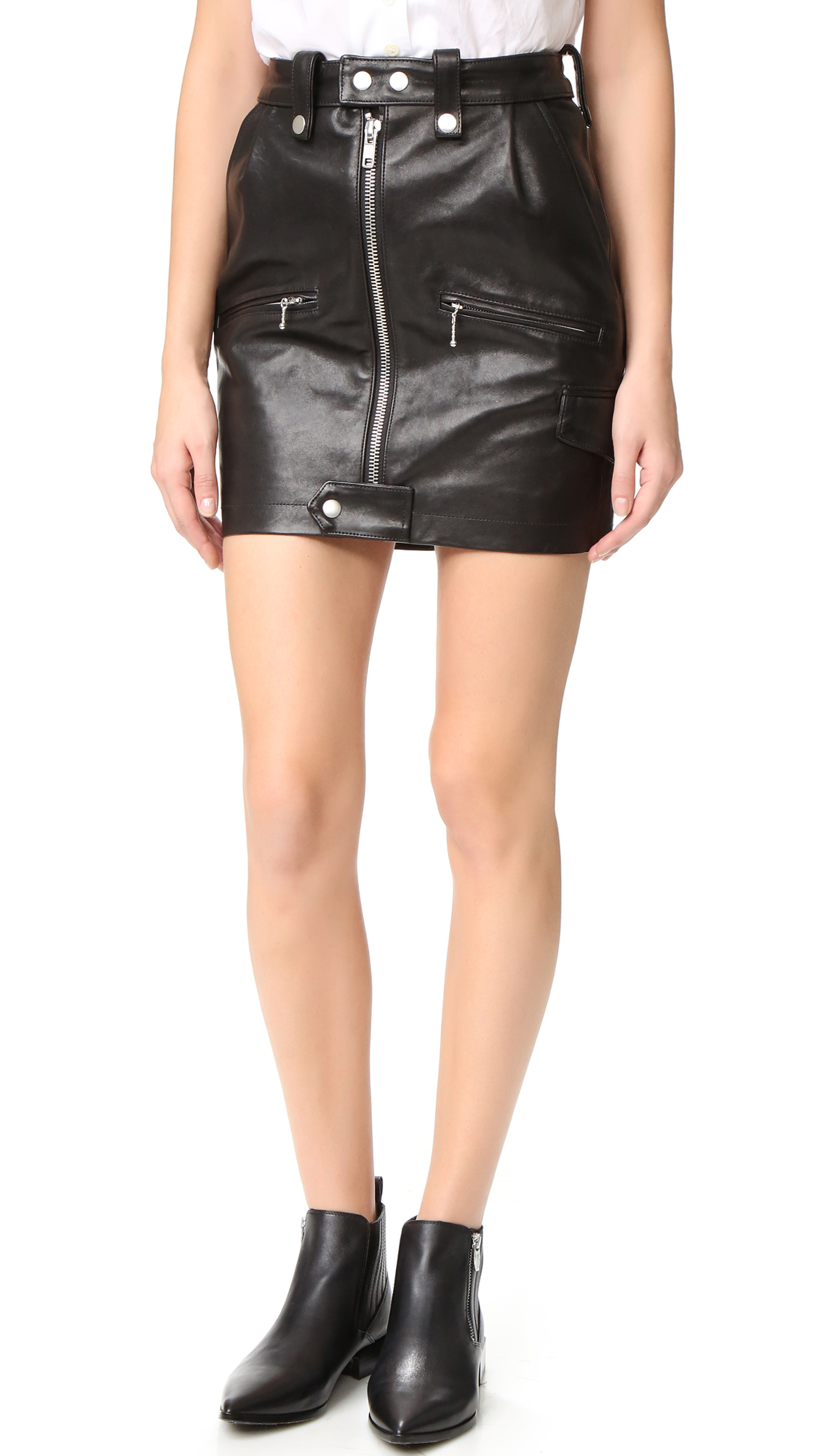 Moto style detailing brings tough edge to this leather FRAME skirt. 5 assorted pockets. Exposed front zip. Lined. Fabric: Glazed leather. Shell: 100% lambskin. Lining 1: 100% cupro. Lining 2: 100% cotton. Leather clean. Imported, China. Measurements Length: 17.75in / 45cm Measurements from