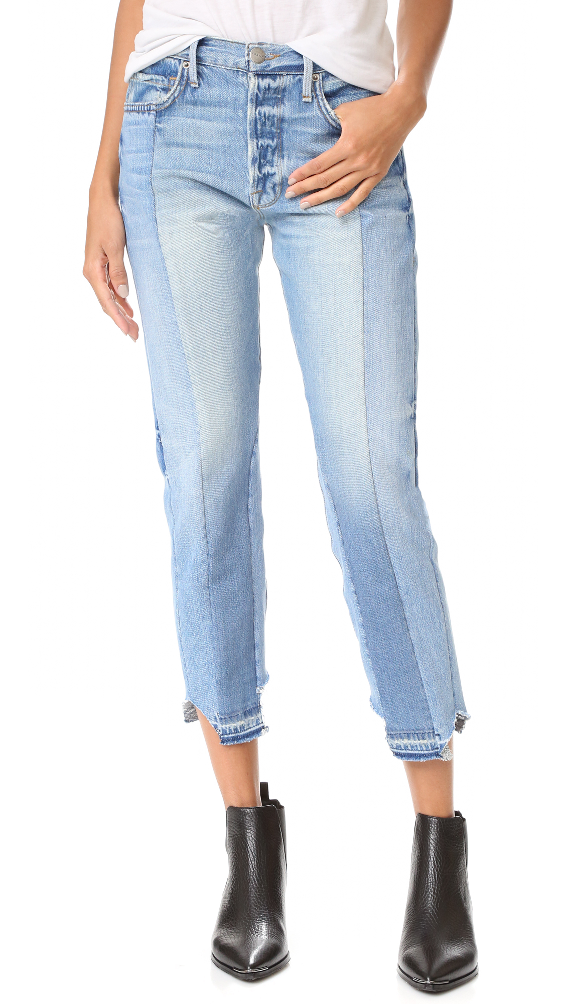 Center seams, mismatched washes, and fading accentuate the patchwork construction of these relaxed FRAME jeans. Raw, notched hem. 5 pocket styling. Button fly. Fabric: Denim. 100% cotton. Wash cold. Made in the USA. Imported materials. Measurements Rise: 10.25in / 26