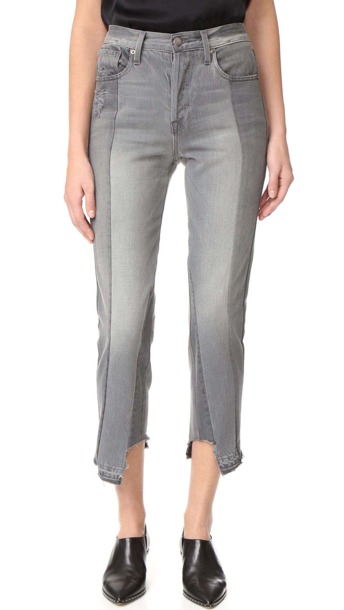 Tonal patchwork composes these cropped FRAME jeans. Frayed cuffs. 5 pocket styling. Button closure and zip fly. Fabric: Denim. 100% cotton. Wash cold. Made in the USA. Measurements Rise: 11in / 28cm Inseam: 26in / 66cm Leg opening: 12.5in / 32cm