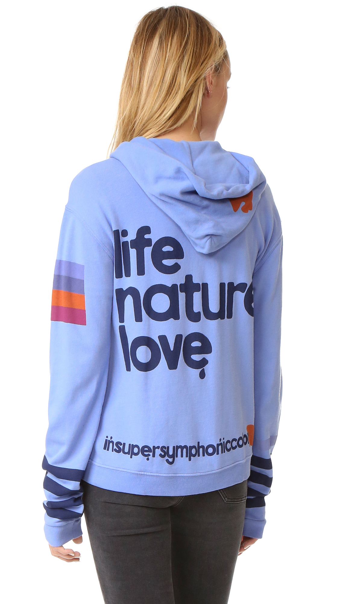 Text and bold graphics lend a signature street style look to this super soft FREECITY hooded sweatshirt. Covered front zip closure. Pouch hip pockets. Fabric: Fleece jersey. 100% cotton. Wash cold. Imported, Peru. Measurements Length: 23.5in / 60cm,