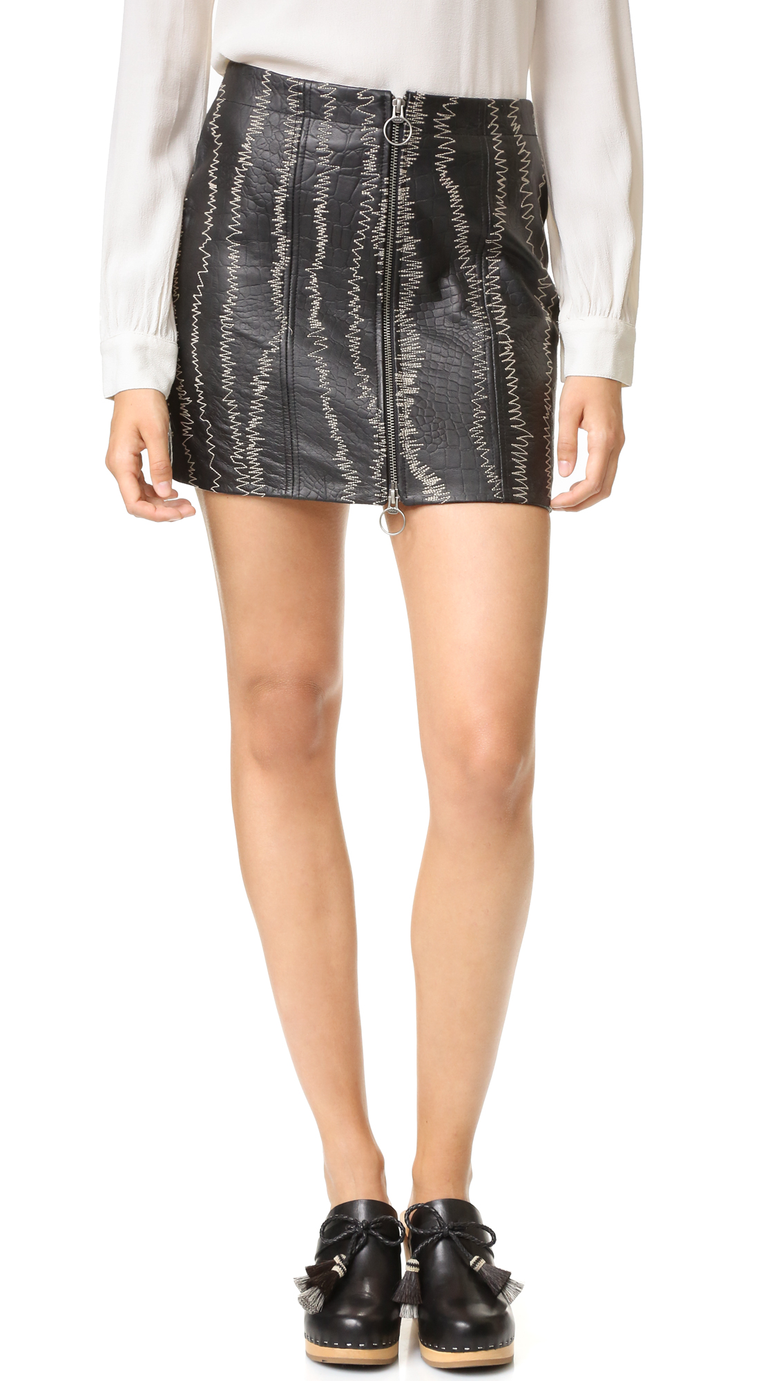 A Free People miniskirt in bold, croc embossed leather. Contrast embroidery adds a unique finish. Exposed front zip. Lined. Fabric: Leather. Shell: 100% lambskin. Lining: 100% rayon. Leather clean. Imported, India. Measurements Length: 14.5in / 37cm Measurements from size 4.