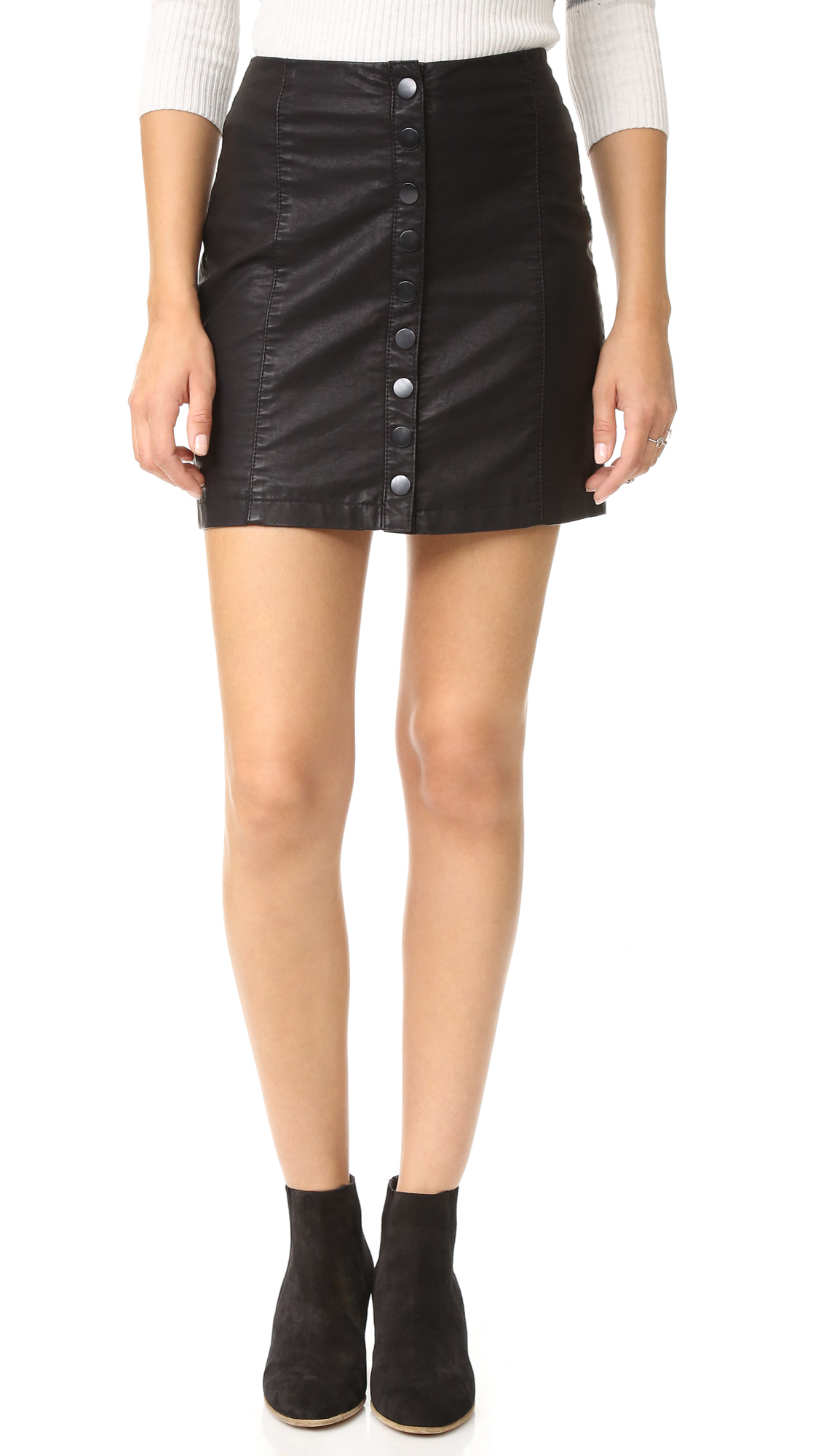 A lightweight, faux leather Free People miniskirt. Snap closures. Lined. Fabric: Faux leather. Shell: 100% polyurethane. Lining: 100% rayon. Hand wash. Imported, China. Measurements Length: 16.25in / 41cm Measurements from size 4. Available sizes: 12