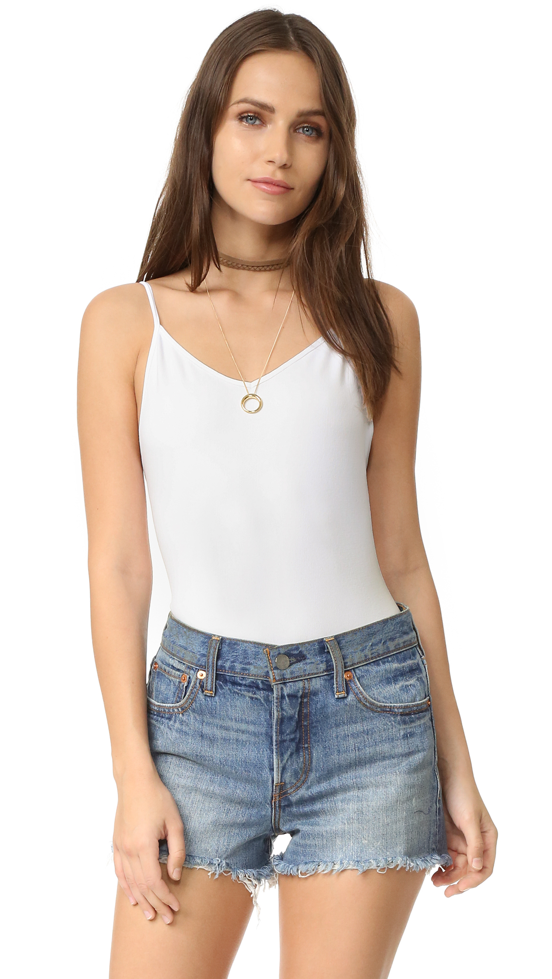 A smooth, lightweight Free People bodysuit. Adjustable spaghetti straps. Low back. Fabric: Smooth jersey. 92% nylon/8% spandex. Wash cold. Made in the USA. Size & Fit. Available sizes: M/L