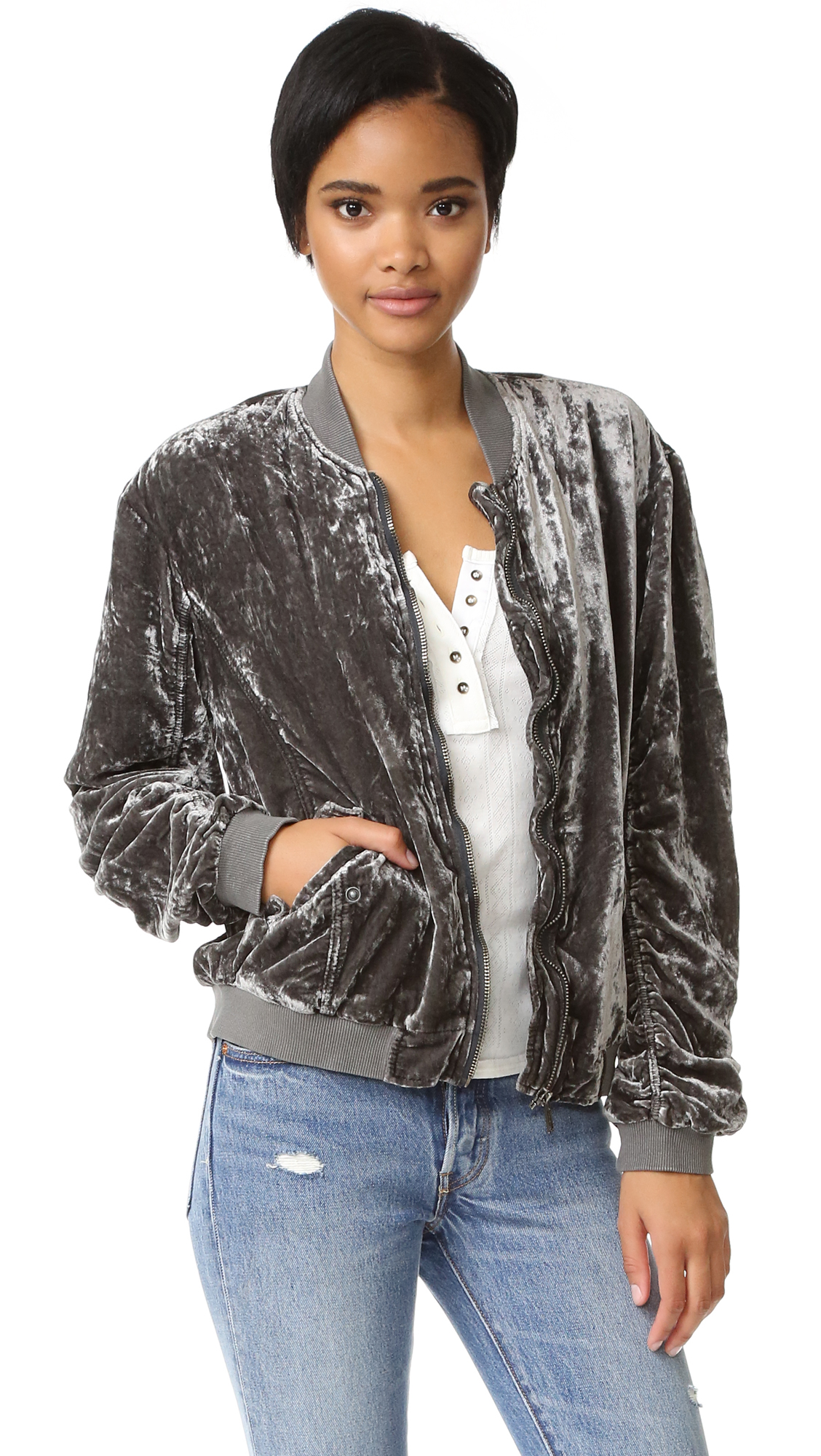 A Free People bomber with a glamorous update. Ruched seams at long sleeves and ribbed edges. Front zip and snap front pockets. Lined. Fabric: Crushed velvet. Shell: 75% viscose/25% nylon. Lining: 100% polyester. Wash cold or dry clean.