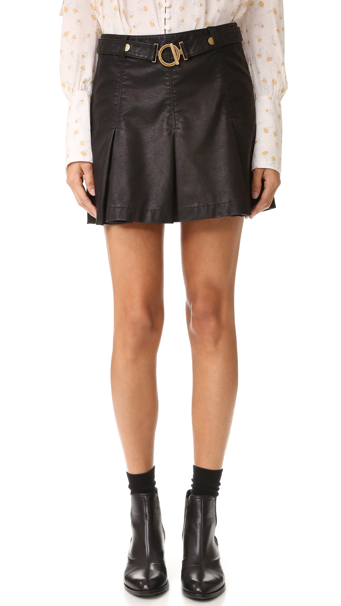 Deep box pleats create a flounced profile on this faux leather Free People skirt. Optional self belt with antiqued hardware. Hidden side zip. Lined. Fabric: Faux leather. Shell: 100% polyurethane. Lining: 100% rayon. Wash cold. Imported, China. Measurements