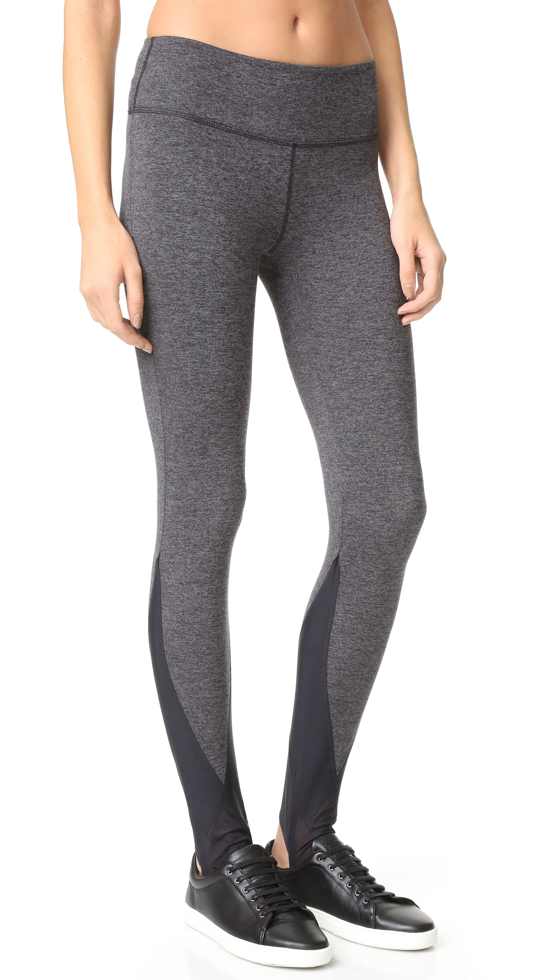 These Free People stirrup leggings are styled with contrast mesh panels. Fabric: Activewear jersey. Shell: 89% polyester/11% spandex. Trim: 90% nylon/10% spandex. Wash cold or dry clean. Imported, Taiwan. Measurements Rise: 9in / 23cm Inseam: 29.25in / 74cm Measurements from