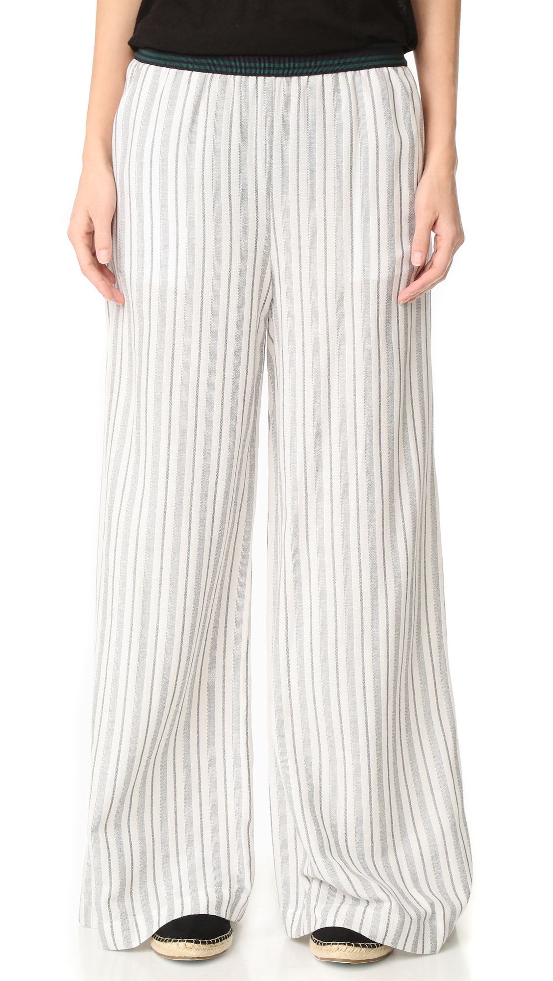 Striated stripes add a graphic touch to these wide leg Free People pants. Exposed elastic waistband with colorful, horizontal stripes. Slant hip pockets. Fabric: Slinky weave. 55% cotton/45% viscose. Hand wash. Imported, Philippines. Measurements Rise: 11.5in / 29cm