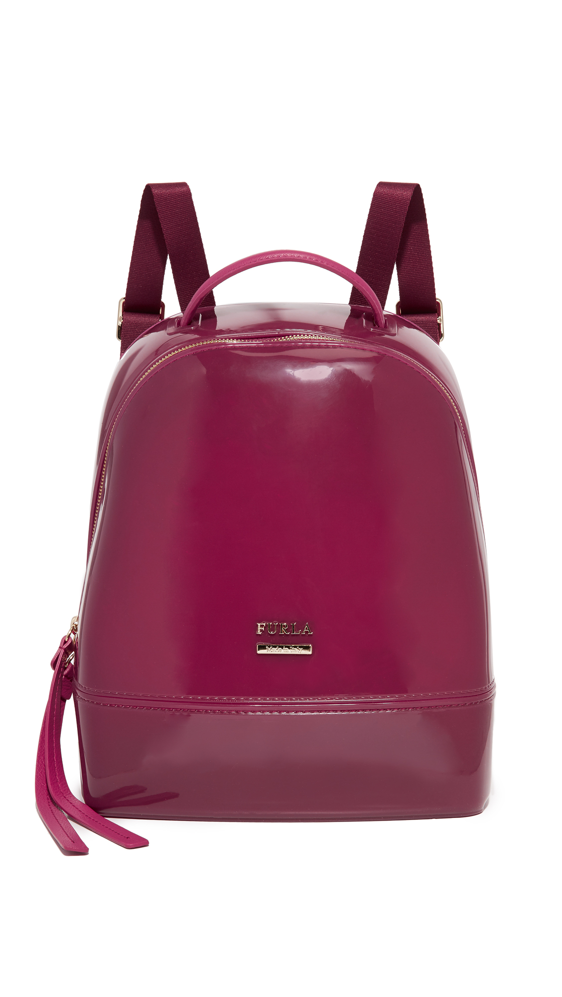 A petite Furla backpack rendered in the brand's signature glossy rubber and finished with leather trim. Polished logo studs and a 2 way top zip. The convertible webbed shoulder straps can be worn as a cross body