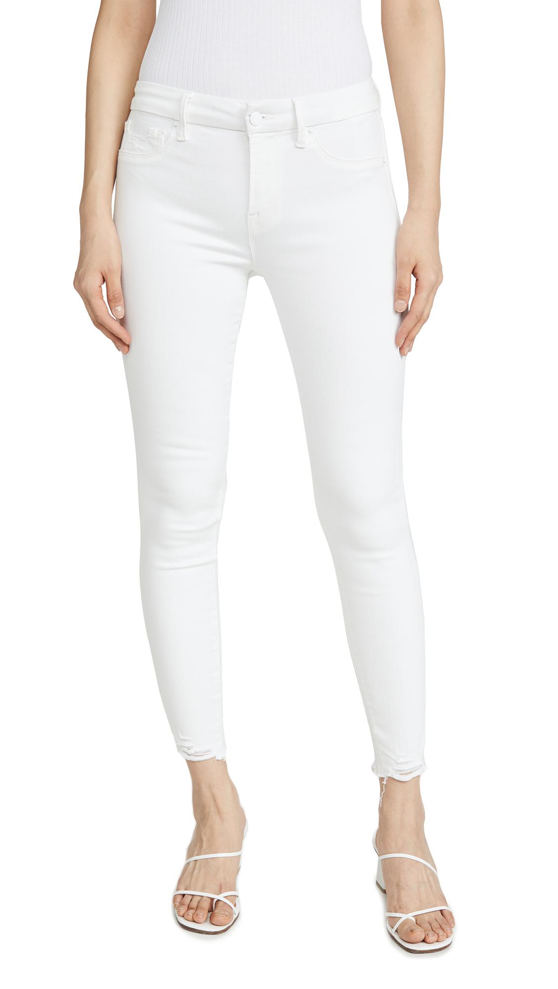 Buy Good American online - photo of Good American Good Legs Skinny Jeans With Chewed Hem