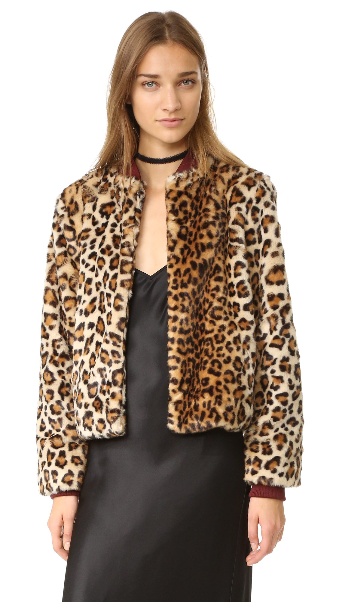 A leopard print faux fur Ganni jacket in a modern, cropped silhouette. Ribbed collar and inset, ribbed knit cuffs. Hook and eye closures secure the placket. On seam hip pockets. Lined. Fabric: Faux fur. Shell: 80% acrylic/20%