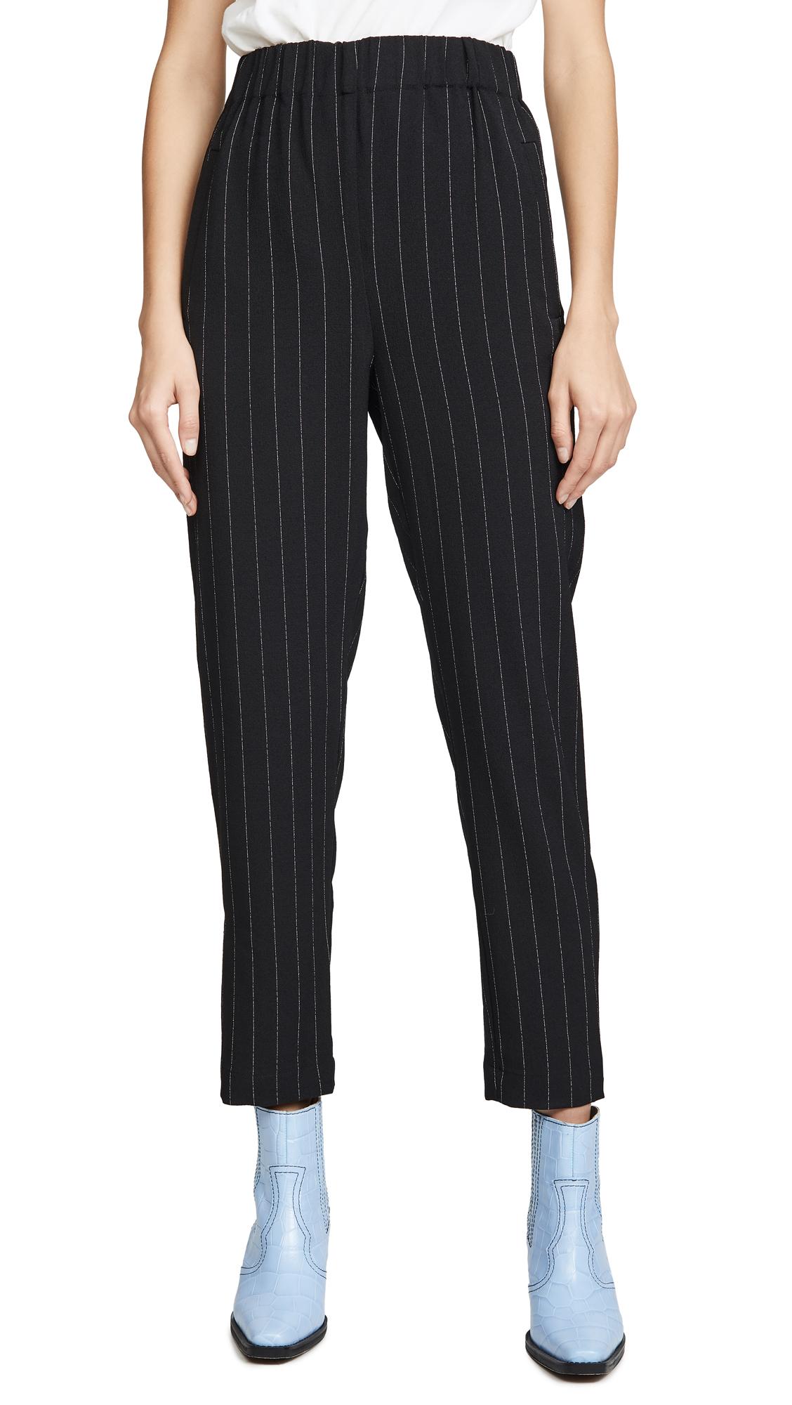 Buy GANNI online - photo of GANNI Slim Fit Crepe Pants