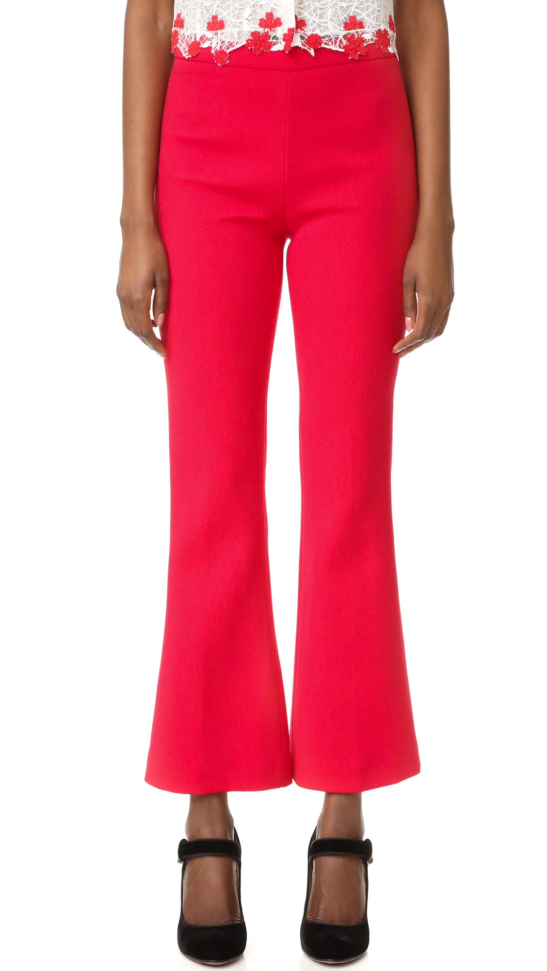 Giambattista Valli pants in a cropped, high waisted silhouette. The straight leg profile is slightly flared at the cuffs. Hidden back zip. Fabric: Mid weight crepe. 45% cotton/39% viscose/16% nylon. Dry clean. Made in Italy. Measurements Rise: 11