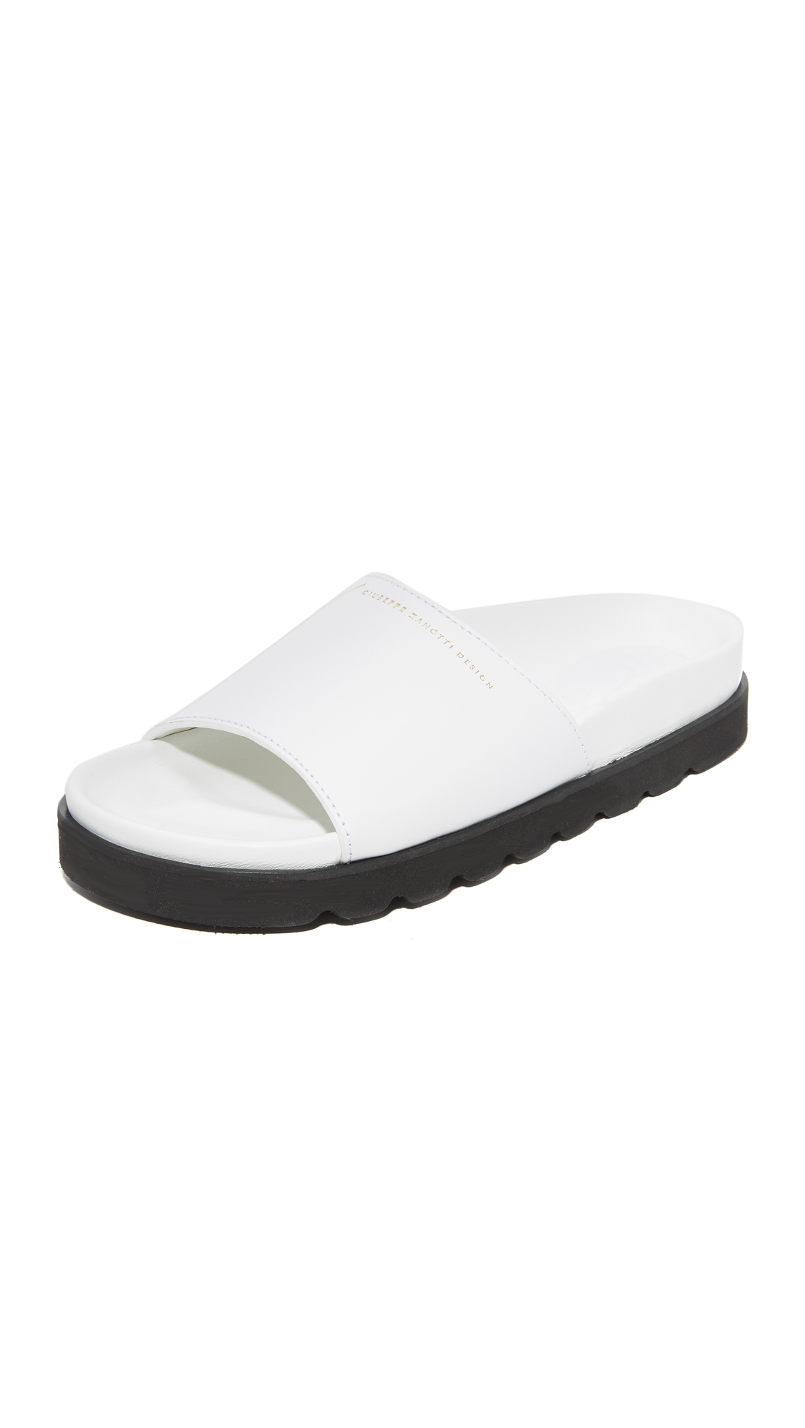 Sporty, two tone Giuseppe Zanotti slides with metallic logo lettering at the leather vamp. Sculpted footbed and foam platform. Rubber sole. Leather: Calfskin. Made in Italy. Size & Fit. Available sizes: 35,36,37,38,39