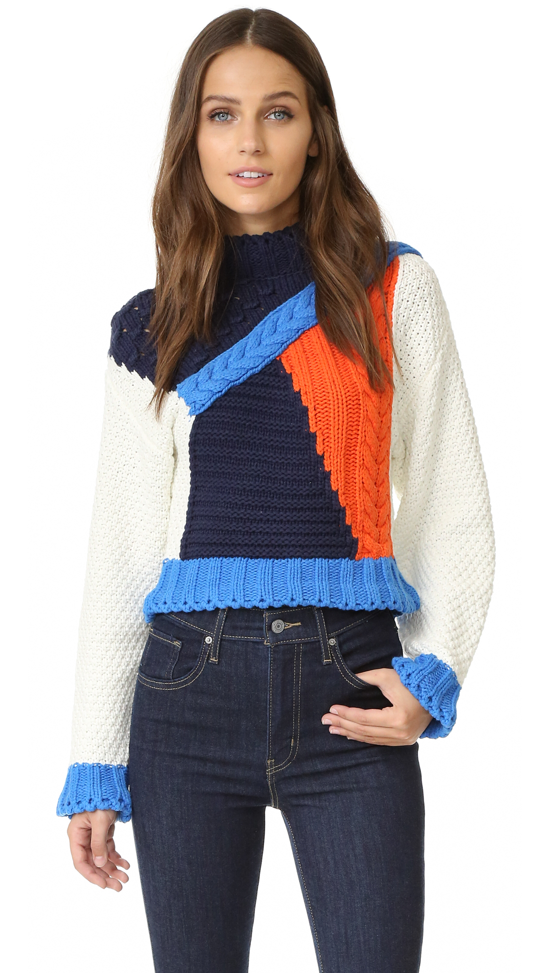 Flared trim accents the edges of this colorblocked Glamorous cropped sweater. Dropped shoulder seams and long sleeves. Fabric: Knit. 60% cotton/40% acrylic. Hand wash. Imported, China. Measurements Length: 19in / 48cm, from shoulder Measurements from size S. Available