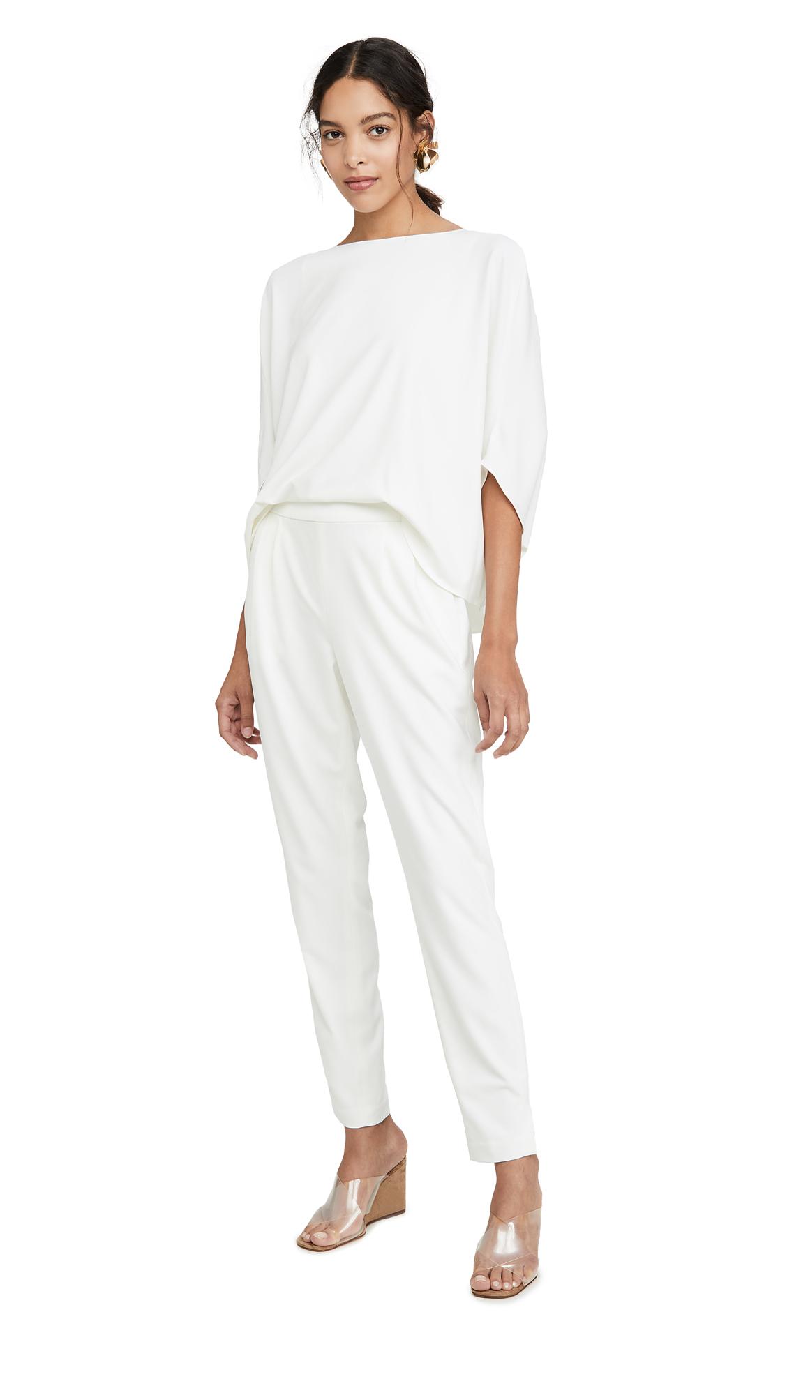 Buy HALSTON online - photo of HALSTON Draped Sleeve Tapered Leg Crepe Jumpsuit