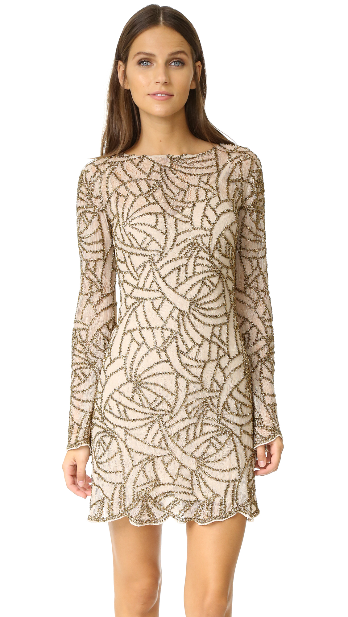 A clean pattern rendered in metallic beads details the delicate lace shell of this Haute Hippie mini dress. Scalloped edges. Long bell sleeves. Hidden back zip. Optional slip dress lining. Fabric: Lace. Shell: 100% nylon. Lining: 97% polyester/3%