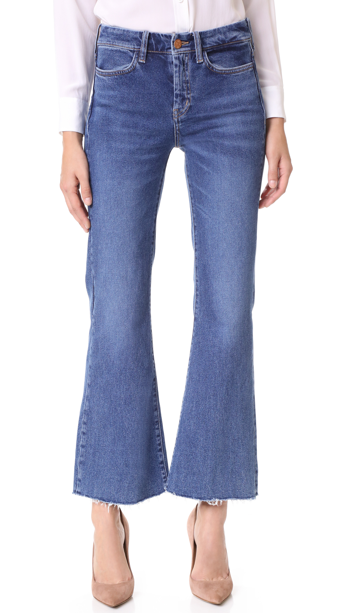 These M.i.h Jeans cropped flares are finished in a faded wash. Frayed cuffs. 4 pocket styling. Single button closure and zip fly. Fabric: Stretch denim. 98% cotton/2% elastane. Wash cold. Imported, Turkey. Measurements Rise: 9.5in / 24cm