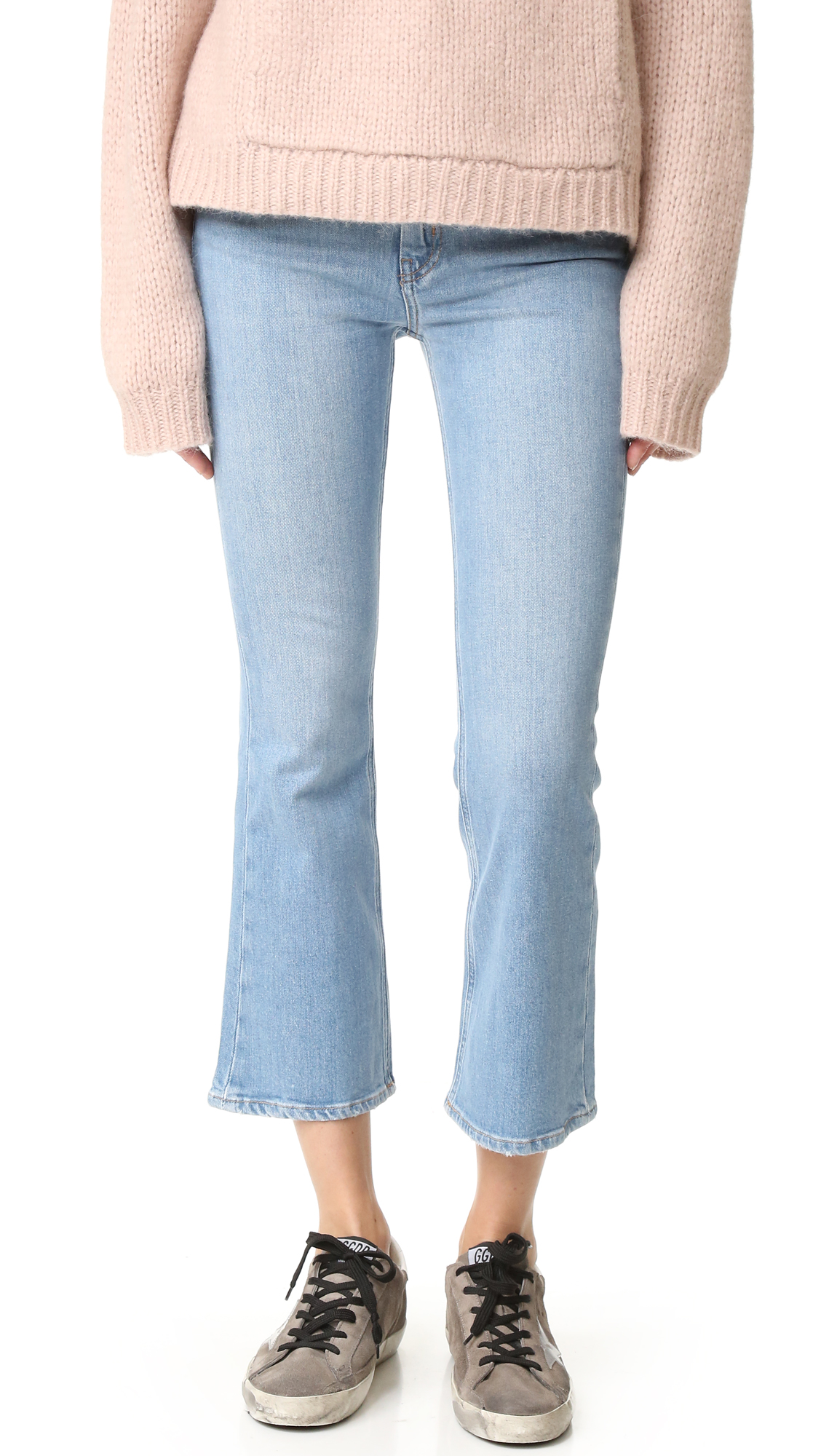 A faded wash complements the time worn softness of these M.i.h Jeans cropped flare jeans. 5 pocket styling. Button closure and zip fly. Fabric: Stretch denim. 98% cotton/2% elastane. Wash cold. Imported, Turkey. Measurements Rise: 9.75in / 25