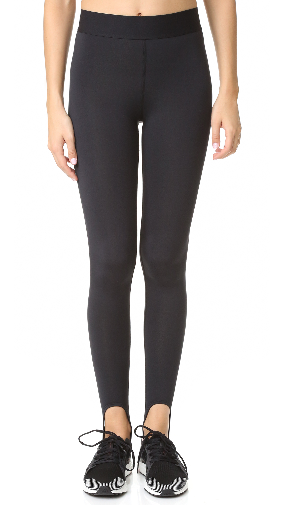 Sleek Heroine Sport stirrup leggings. Exposed elastic waistband with logo patch. Fabric: Ponte jersey. 90% polyester/10% spandex. Wash cold. Made in the USA. Measurements Rise: 11.5in / 29cm Inseam: 25.25in / 64cm Measurements from size S. Available sizes: S,