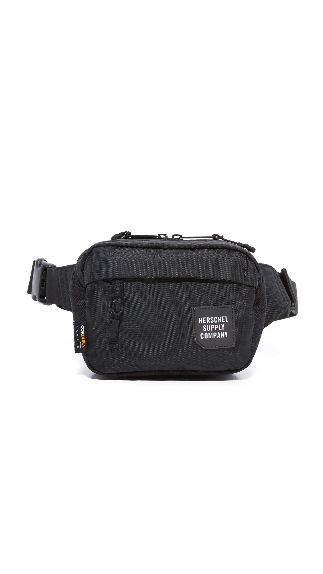 A petite Herschel Supply Co. fanny pack in a sturdy weave, accented with a logo patch in front. Zip front pocket. Top zip and lined interior. Adjustable buckle belt. Fabric: Technical weave. Weight: 6oz / 0.17kg. Imported,
