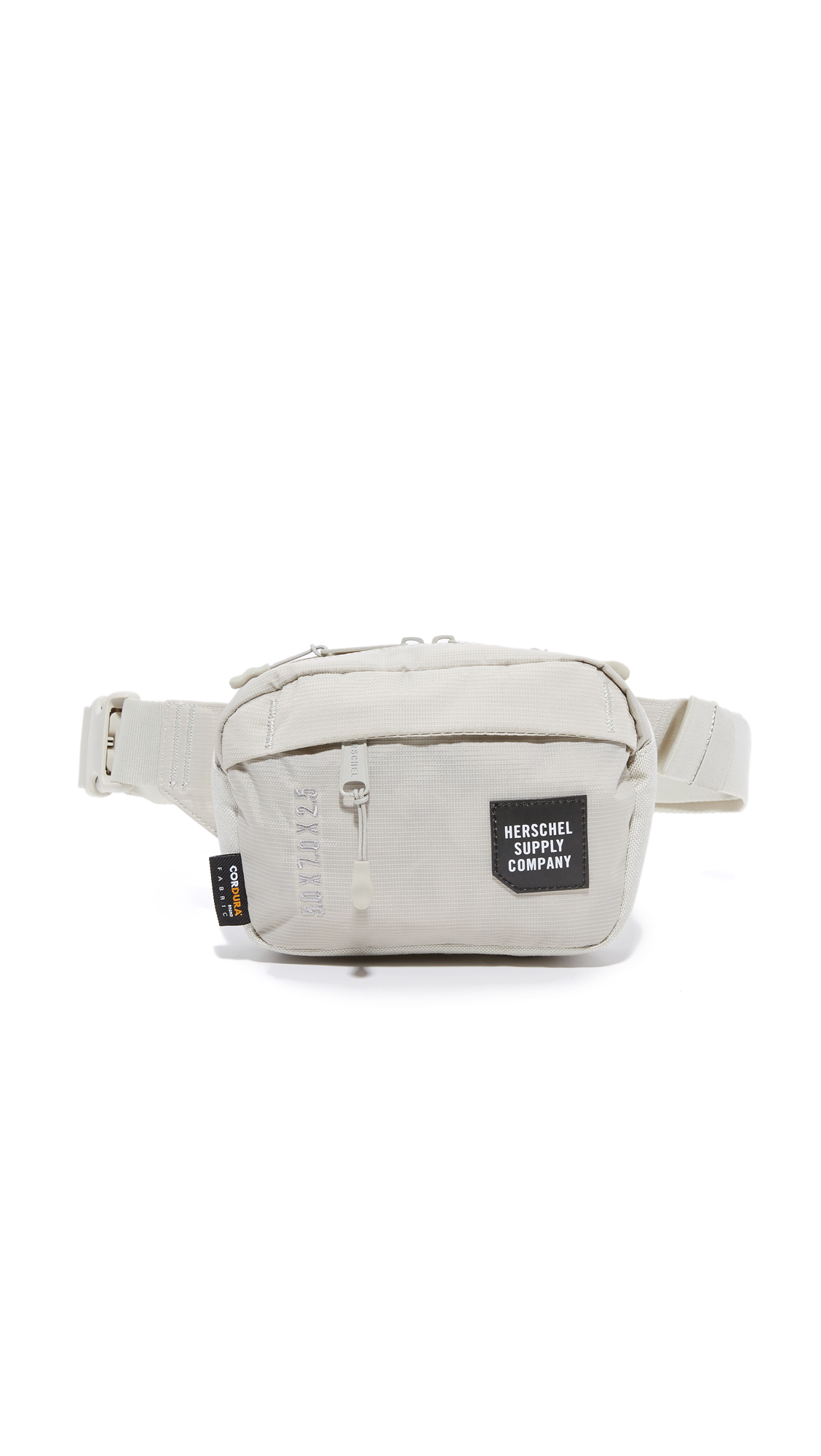 This petite Herschel Supply Co. fanny pack is cut from a durable fabric. Zip front pocket. Wraparound top zip and unlined interior. Adjustable buckle belt. Fabric: Technical weave. Weight: 5oz / 0.14kg. Imported, Vietnam. Measurements Height: 5.5in / 14