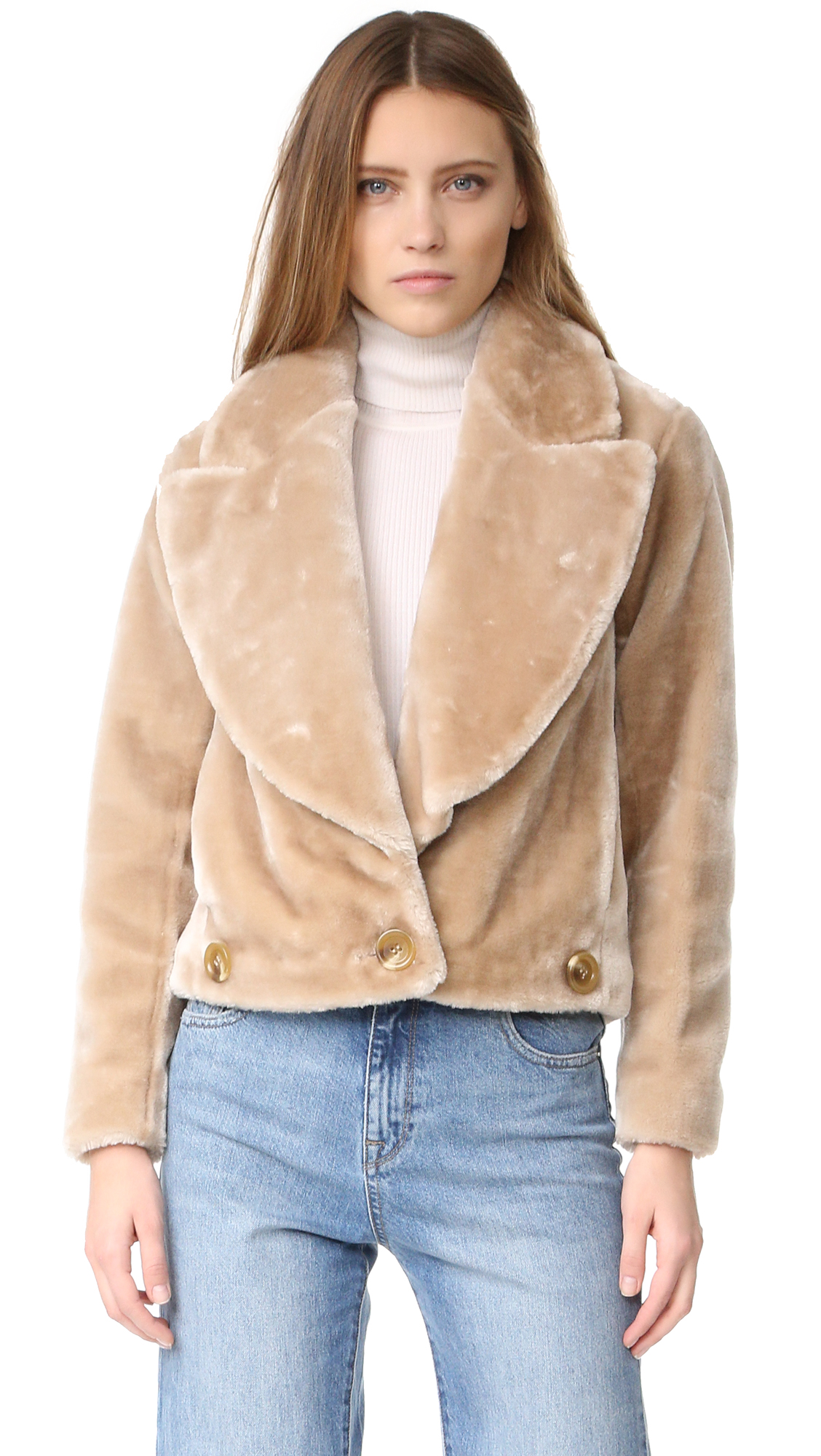 A boxy Intropia moto jacket, composed of plush faux fur. Wide lapels frame the placket, which is secured at the hem with a single button. On seam hip pockets. Voile lining. Fabric: Faux fur. Shell: 100% polyester.