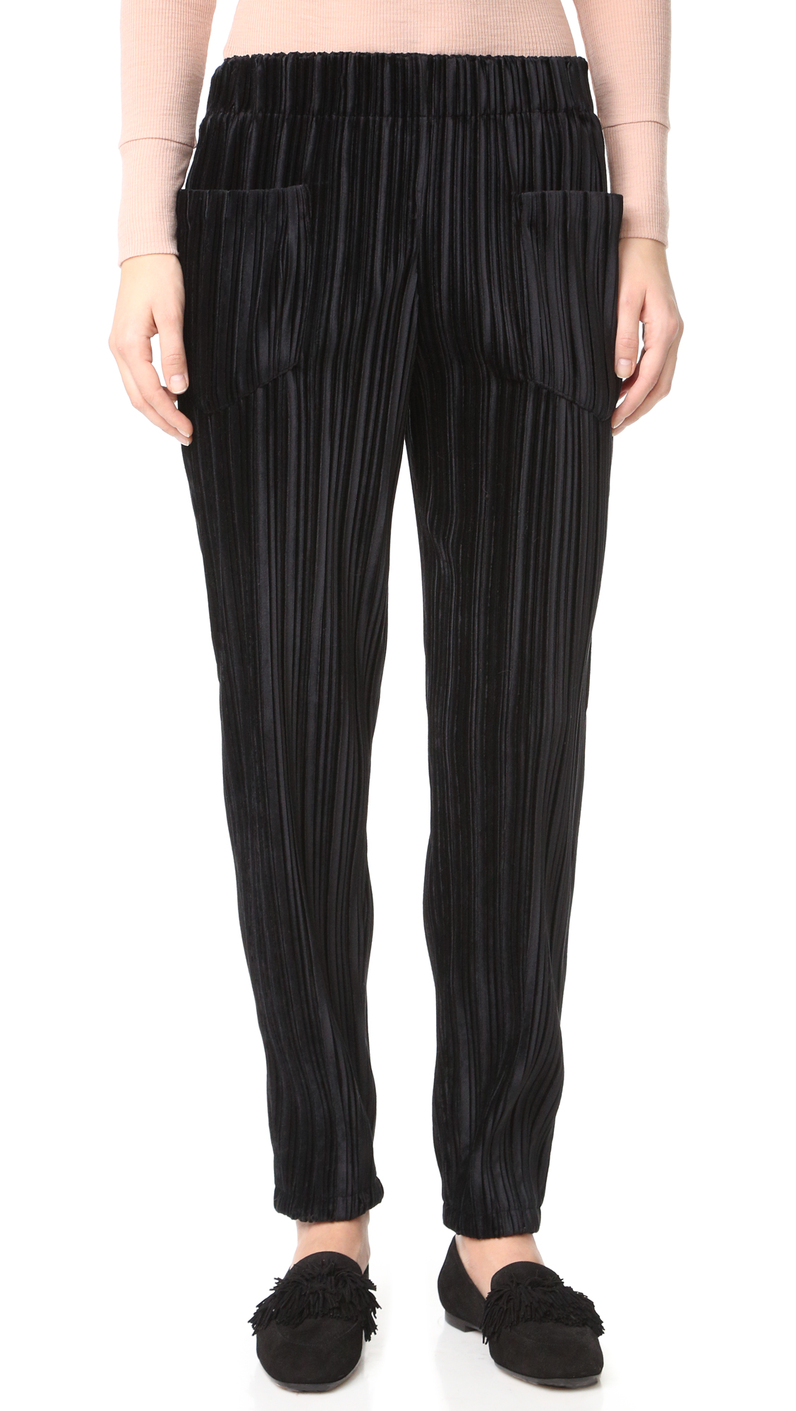 Ribbed velvet Intropia trousers in a slim silhouette. Patch hip pockets. Covered elastic waistband. Fabric: Velvet. 100% polyester. Hand wash or dry clean. Imported, China. Measurements Rise: 11.5in / 29cm Inseam: 28.25in / 72cm Leg opening: 11.75in / 30cm Measurements