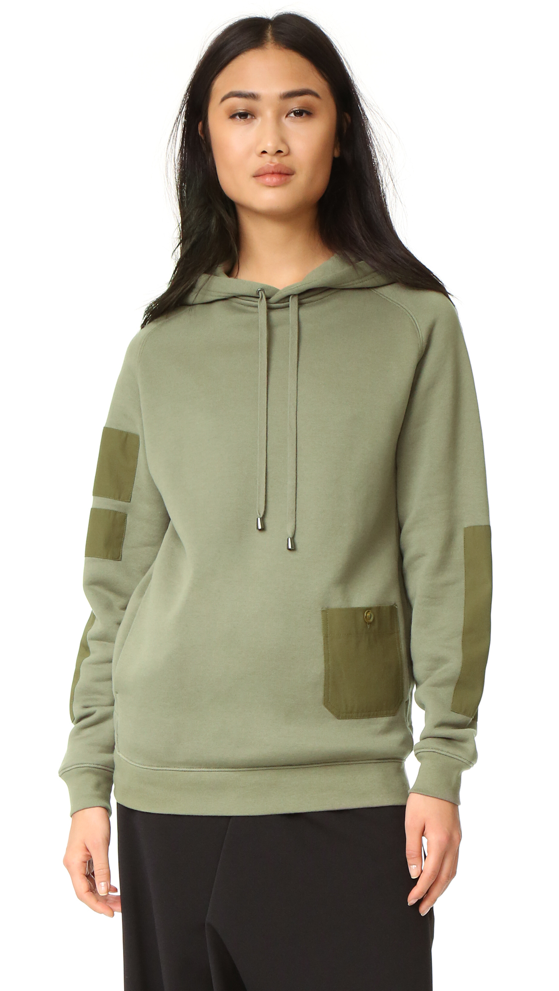 Tonal patches of smooth fabric add a subtle, graphic element to this Helmut Lang hooded sweatshirt. On seam hip pockets and patch front pocket. An internal tab cinches the waist. Fabric: French terry. Shell: 100% cotton. Trim: 90%