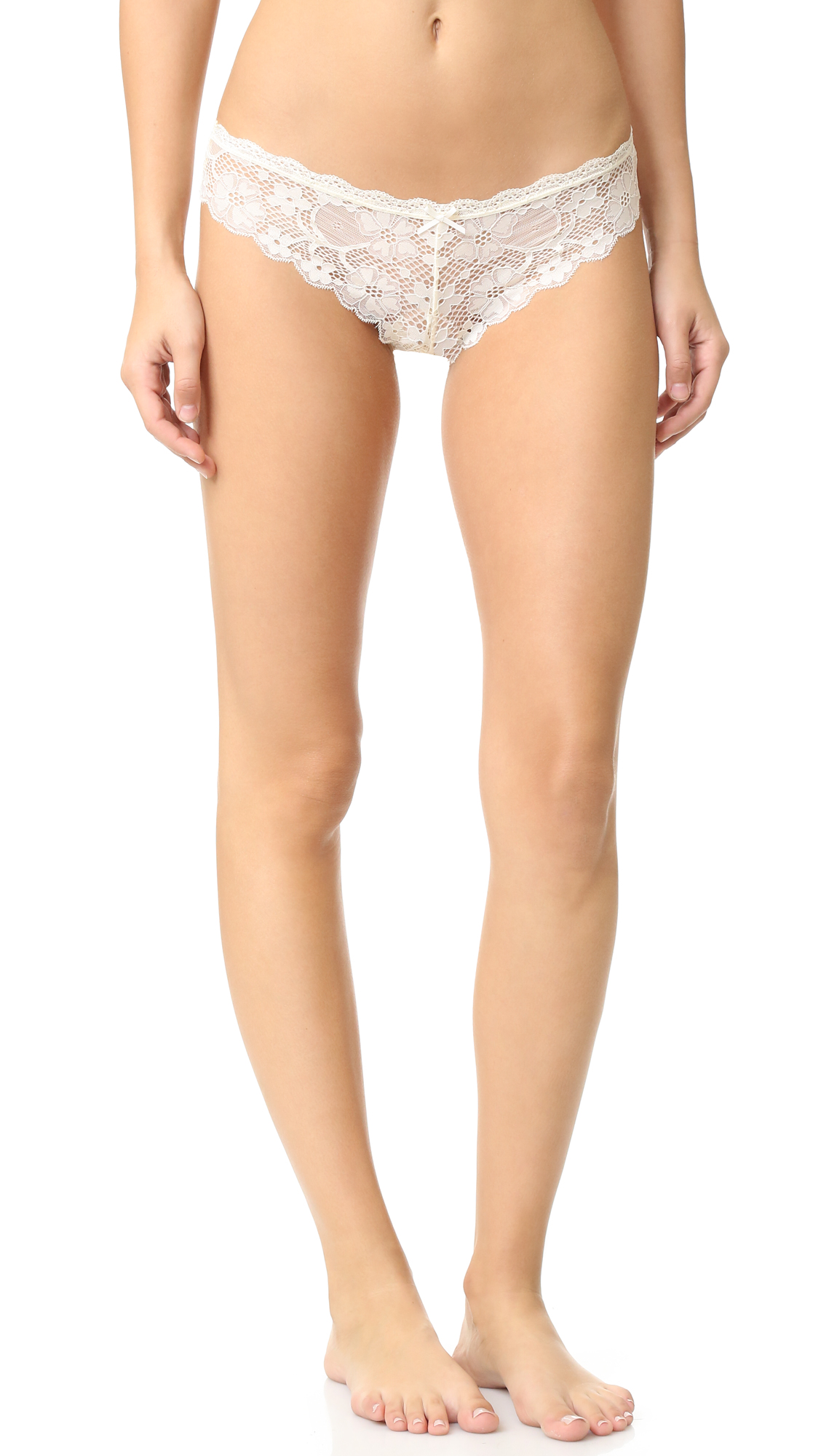 A Honeydew Intimates thong in floral lace. Scalloped edges. Jersey gusset. 82% nylon/18% spandex. Wash cold. Imported, China.