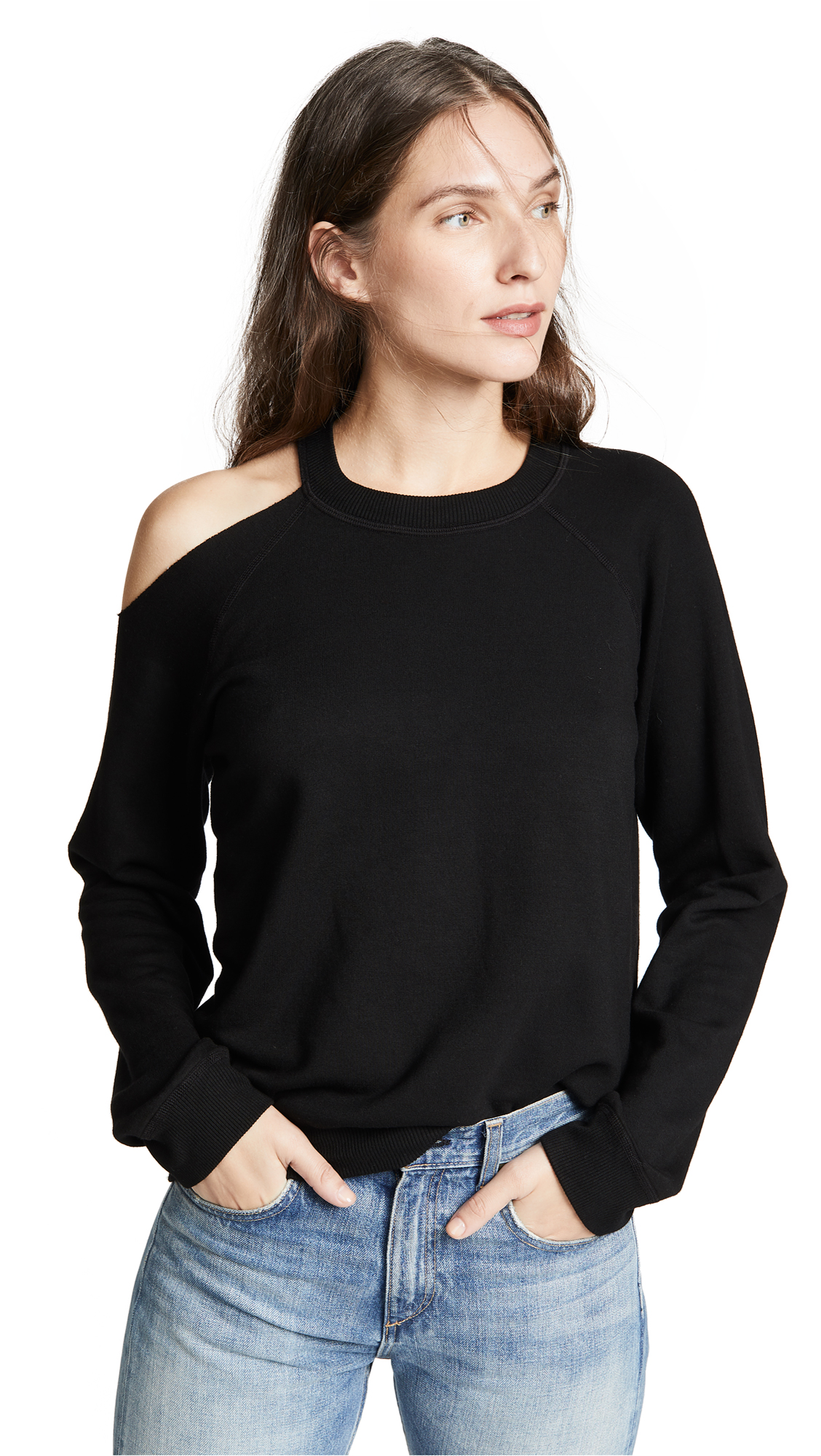 Fabric: Fleece Ribbed trim Shoulder cutout Pullover sweatshirt style Waist-length style Crew neck Long sleeves Shell: 67% rayon/30% cotton/3% spandex Trim: 97% rayon/3% spandex Wash cold Made in the USA Measurements Measurements from size S Length: 22.5in / 57cm, from shoulder