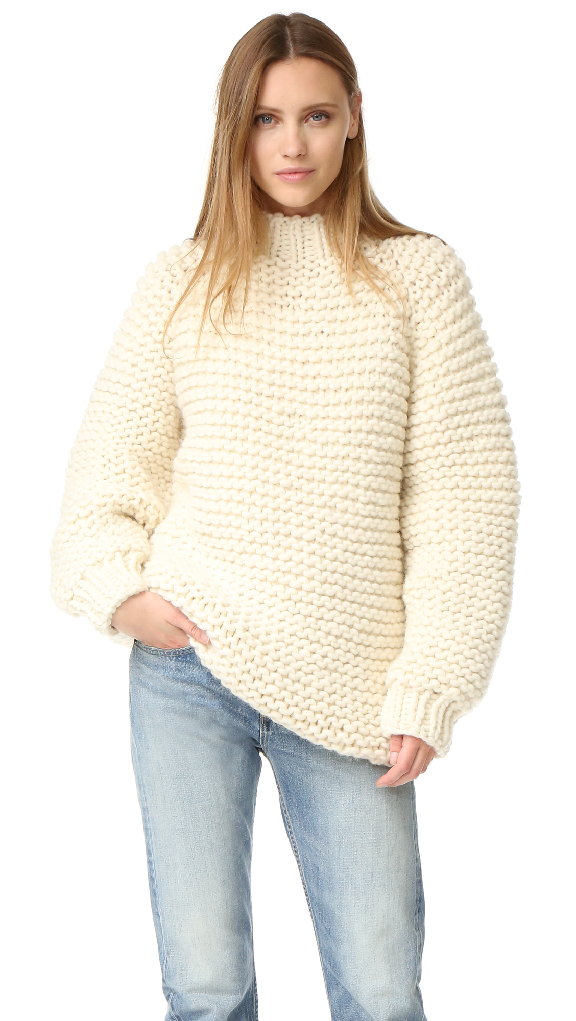 A ultra cozy I Love Mr Mittens turtleneck sweater, composed of chunky, open knit. Long raglan sleeves. Ribbed edges. Fabric: Chunky knit. 100% wool. Hand wash or dry clean. Imported, Peru. Measurements Length: 26.5in / 67cm, from shoulder